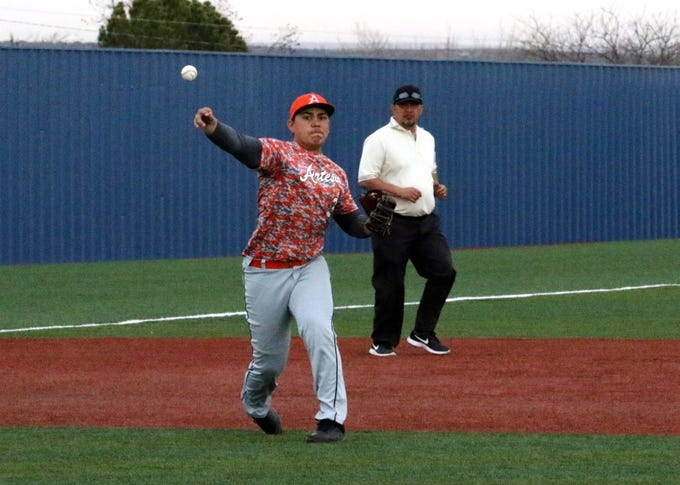 Artesia third baseman Aaron Natera throws out a Valencia running in the first inning of Thursday's game. Artesia won, 12-5.