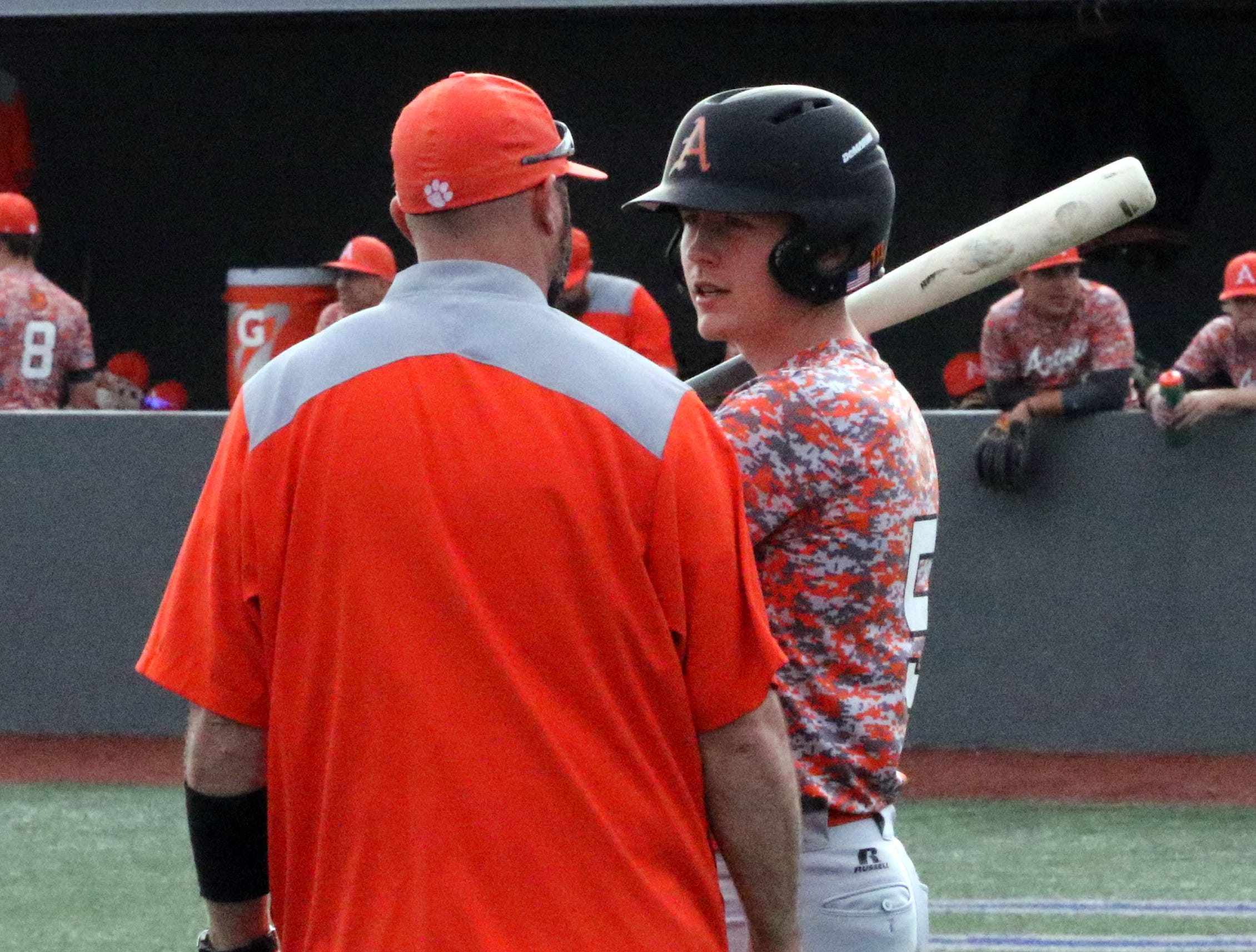Artesia coach JJ Ortiz goes over instructions with Collin Turner during Thursday's game against Valencia. Artesia won, 12-5.Artesia won, 12-5.