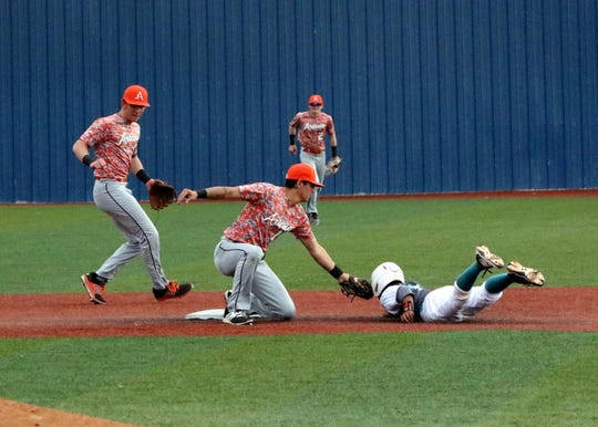 Artesia second baseman Cooper Flores tags out a Valencia runner attempting to steal second base.