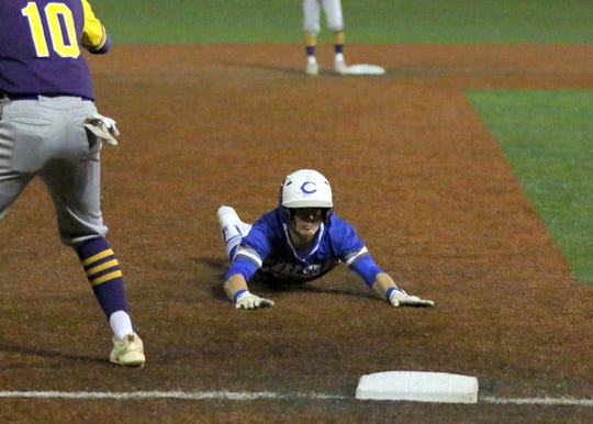 Evan Smith safely slides into third base during the first inning of Thursday's game against Burges. Carlsbad won, 15-1 in five innings.