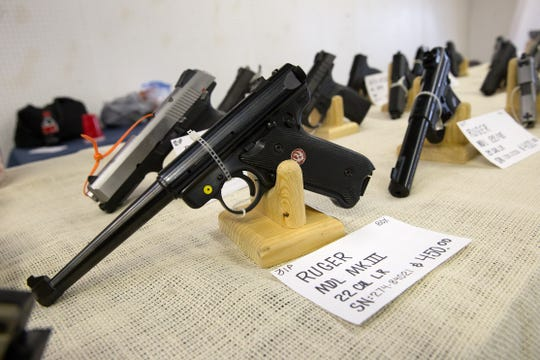 """A collection of hand guns owned by Robert """"Bud"""" Light is displayed, Friday, Feb. 3, 2017 at the San Juan Wildlife Federation Gun and Knife Show at McGee Park in Farmington."""