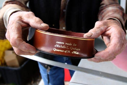Ramie Harper holds the inner band of the hat he is making for Gov. Michelle Lujan Grisham Thursday in Fruitland.