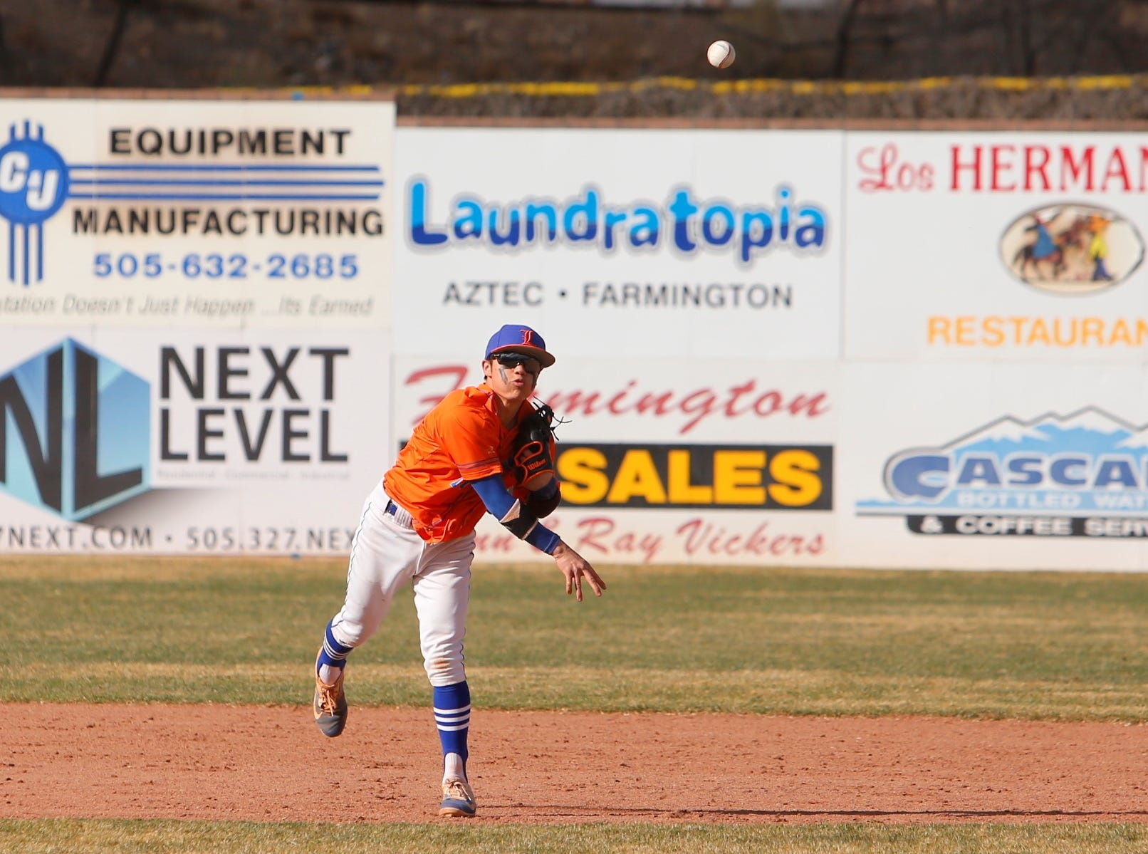 Kees Cieremans of Los Lunas throws down to first base for an out against Farmington during Thursday's FHS Scorpion Invitational tournament game at Ricketts Park in Farmington.