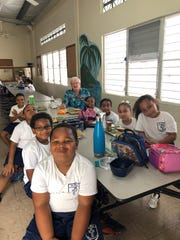 First grade students along with their substitute teacher, Tedd Wallace of South Lyon, Michigan, at St. Mary's Catholic School in Christiansted, St. Croix, U.S. Virgin Islands on March 8, 2019.