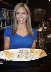 5th Avenue will have a small but filling menu for its patrons and can whip up a wide variety of sushi for its guests. Server Heather Pennington shows off their sushi boat of goodness.