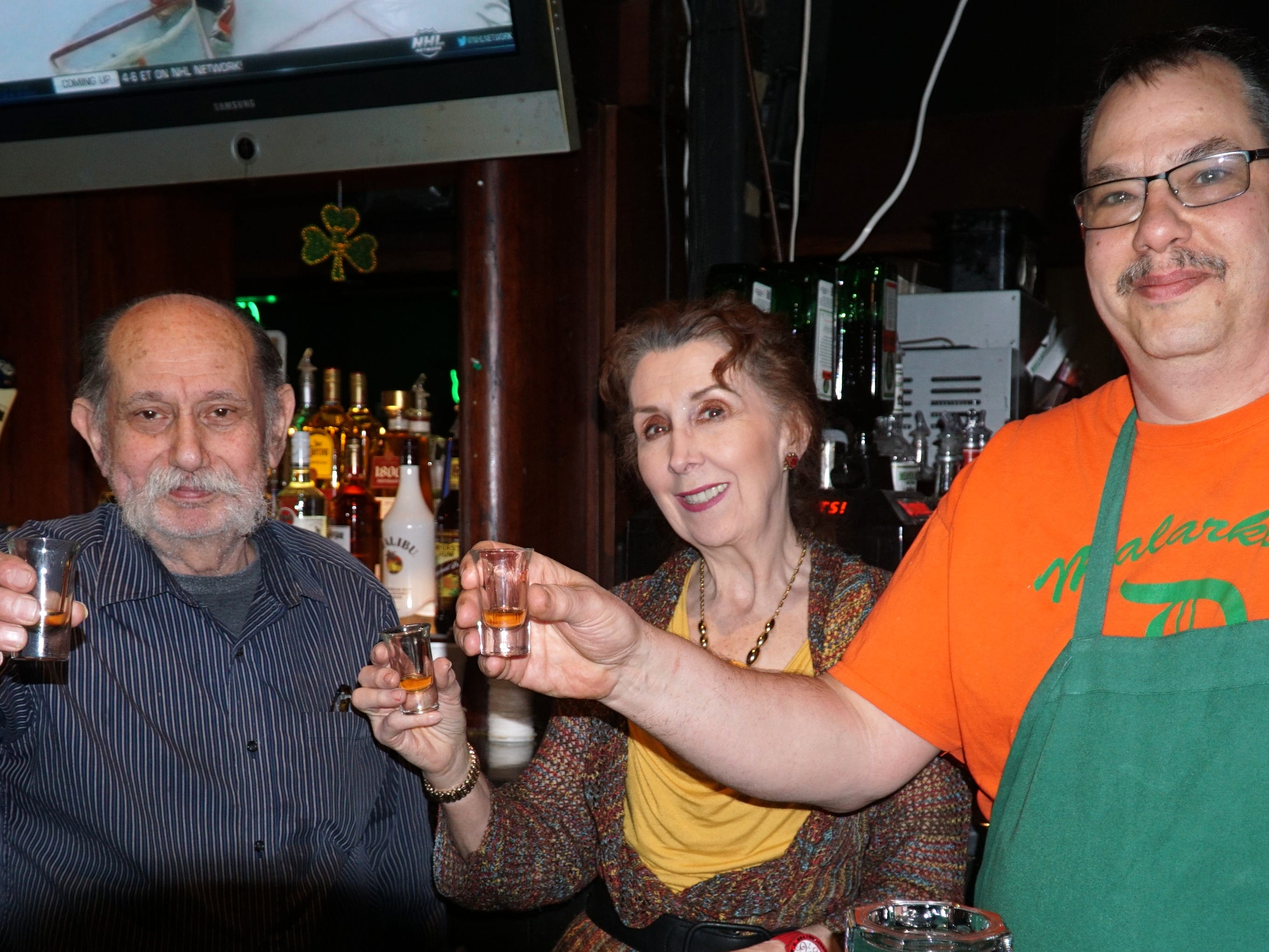 Domenico and Carol Policiccihio and their son Domenico Jr., raise a shot of Grand Marnier to toast farewell to their longtime pub in Westland.