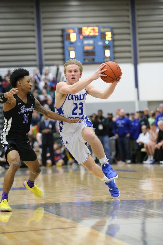 Catholic Central senior Jacob Woebkenberg  drives to the hoop.
