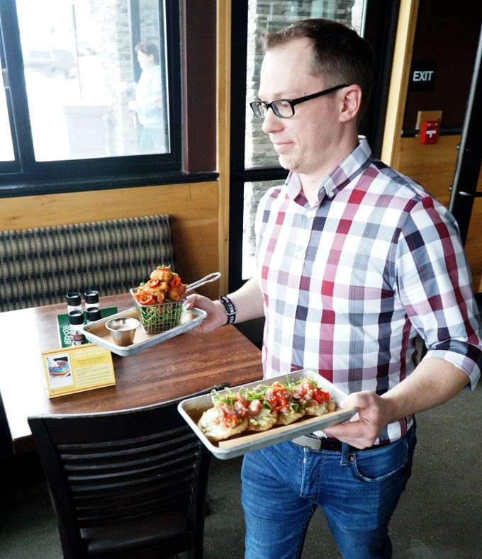 Granite City's Eric Sredzinski has helped to re-design the restaurant's menu with small plate items like Street Corn Fritter, left, and Poke Tuna Tostadas.