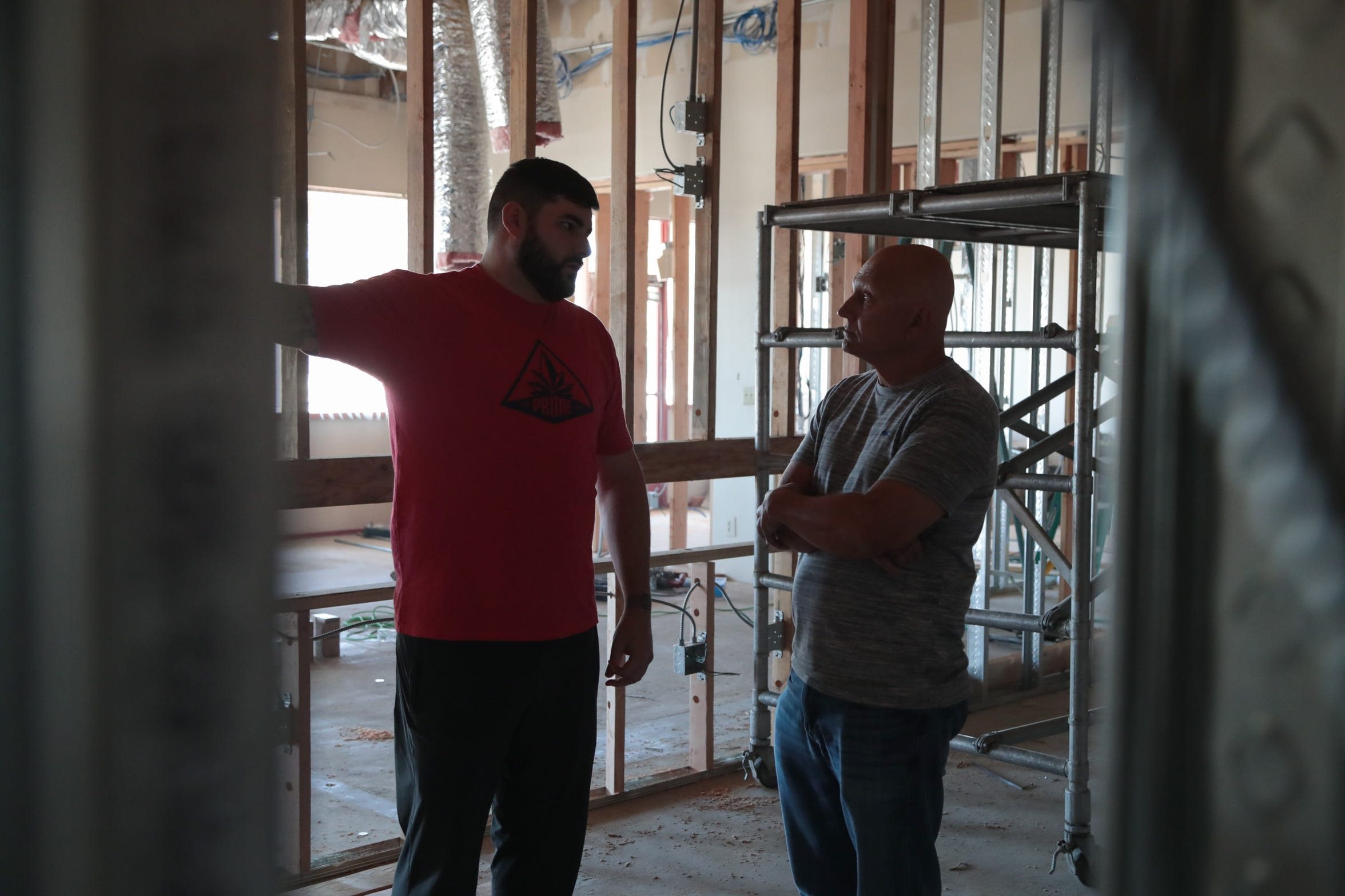 On March 5, 2019, Trevor Farrage, left, and his father, Michael, discuss plans for The Prime Leaf, a dispensary that will open in Blythe, Calif.