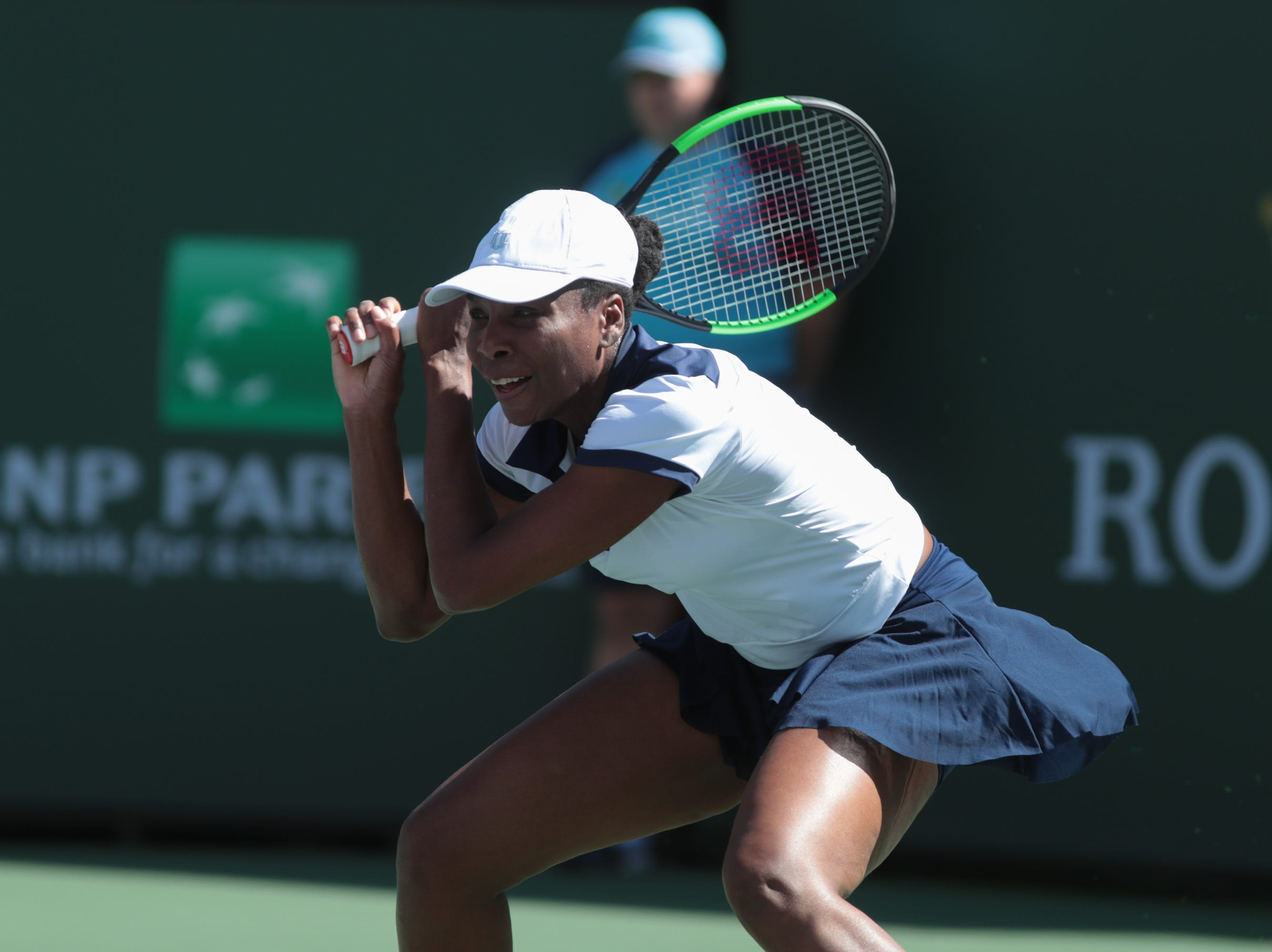 Venus Williams returns to Andrea Petkovic at the BNP Paribas Open, Indian Wells, Calif., Thursday, March 7, 2019.