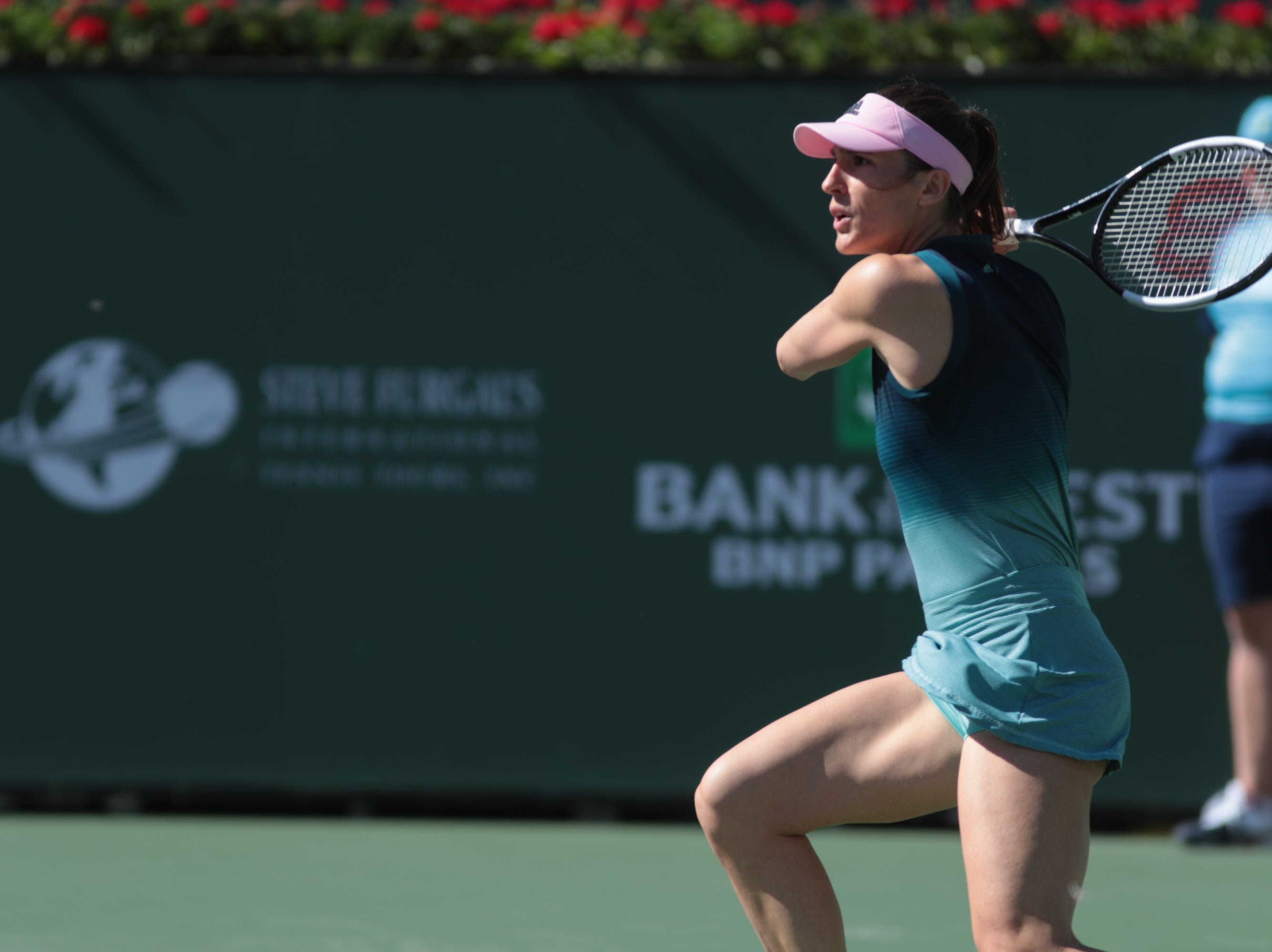 Andrea Petkovic returns to Venus Williams at the BNP Paribas Open, Indian Wells, Calif., Thursday, March 7, 2019.