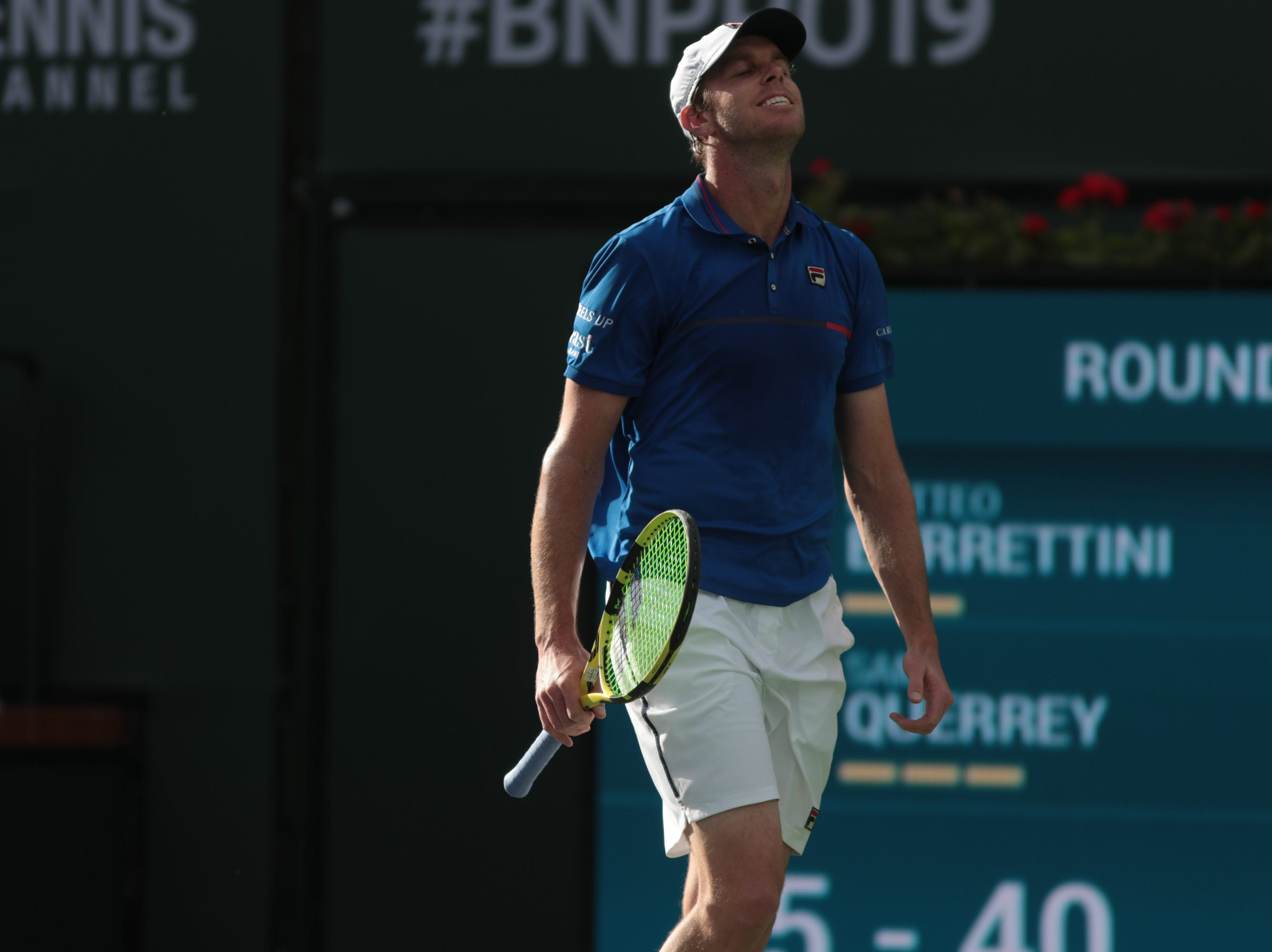 Sam Querrey reacts to a point against Matteo Berrettini at the BNP Paribas Open, Indian Wells, Calif., Thursday, March 7, 2019.