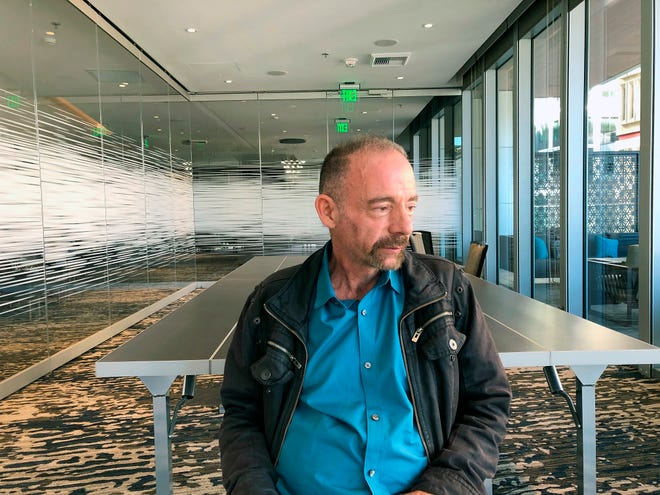 """Timothy Ray Brown is photographed on Monday, March 4, 2019, in Seattle. Brown, also known as the """"Berlin patient,"""" was the first person to be cured of HIV infection, more than a decade ago. Now researchers are reporting a second patient has lived 18 months after stopping HIV treatment without sign of the virus following a stem-cell transplant. But such transplants are dangerous, cannot be used widely and have failed in other patients. (AP Photo/Manuel Valdes)"""