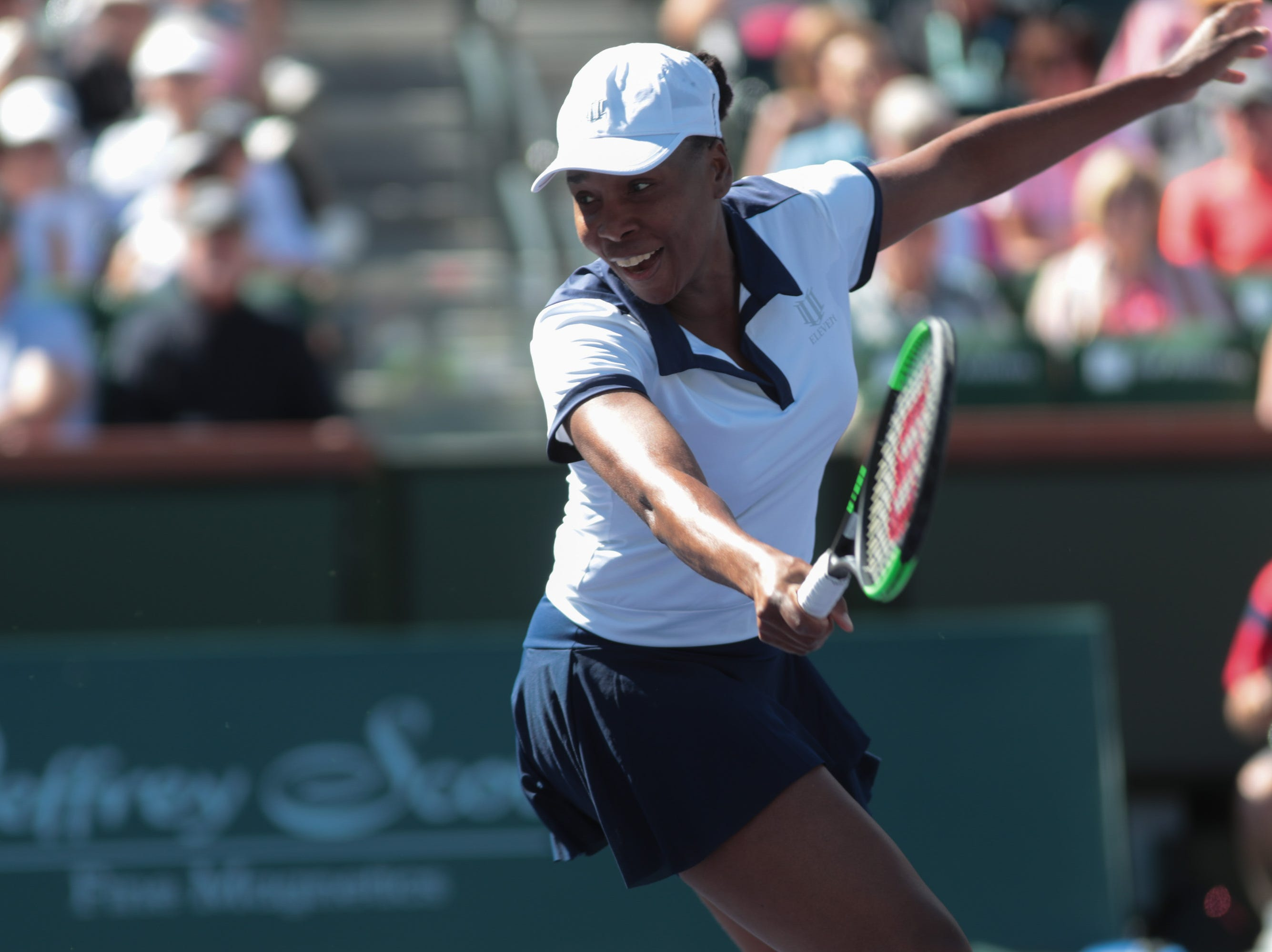 Venus Williams reacts to a passing shot from Andrea Petkovic at the BNP Paribas Open, Indian Wells, Calif., Thursday, March 7, 2019.