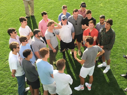 Roger Federer shares his expertise with the members of the Boston College men's tennis team Thursday at the BNP Paribas Open.