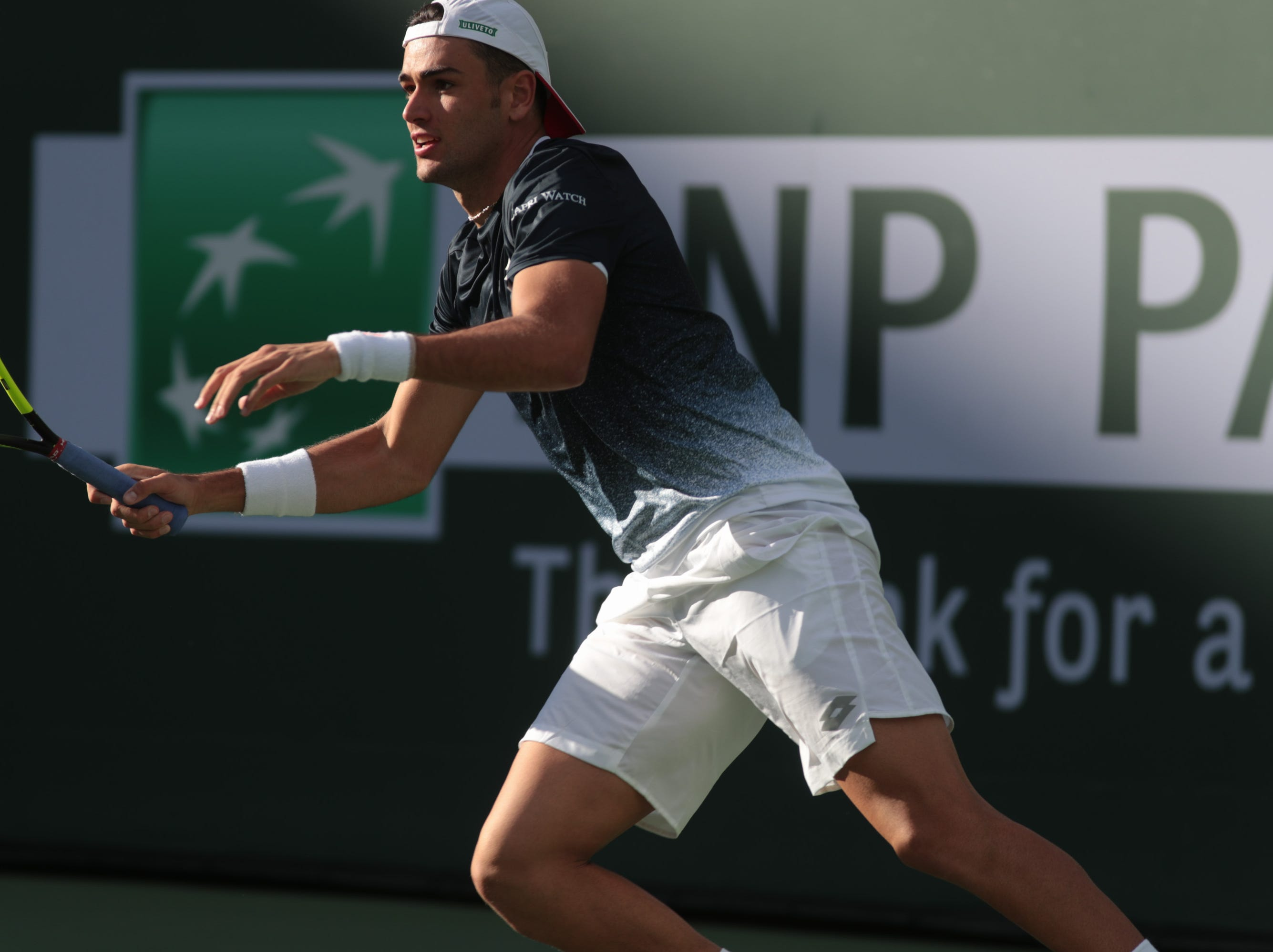 Matteo Berrettini returns a point to Sam Querrey at the BNP Paribas Open, Indian Wells, Calif., Thursday, March 7, 2019.