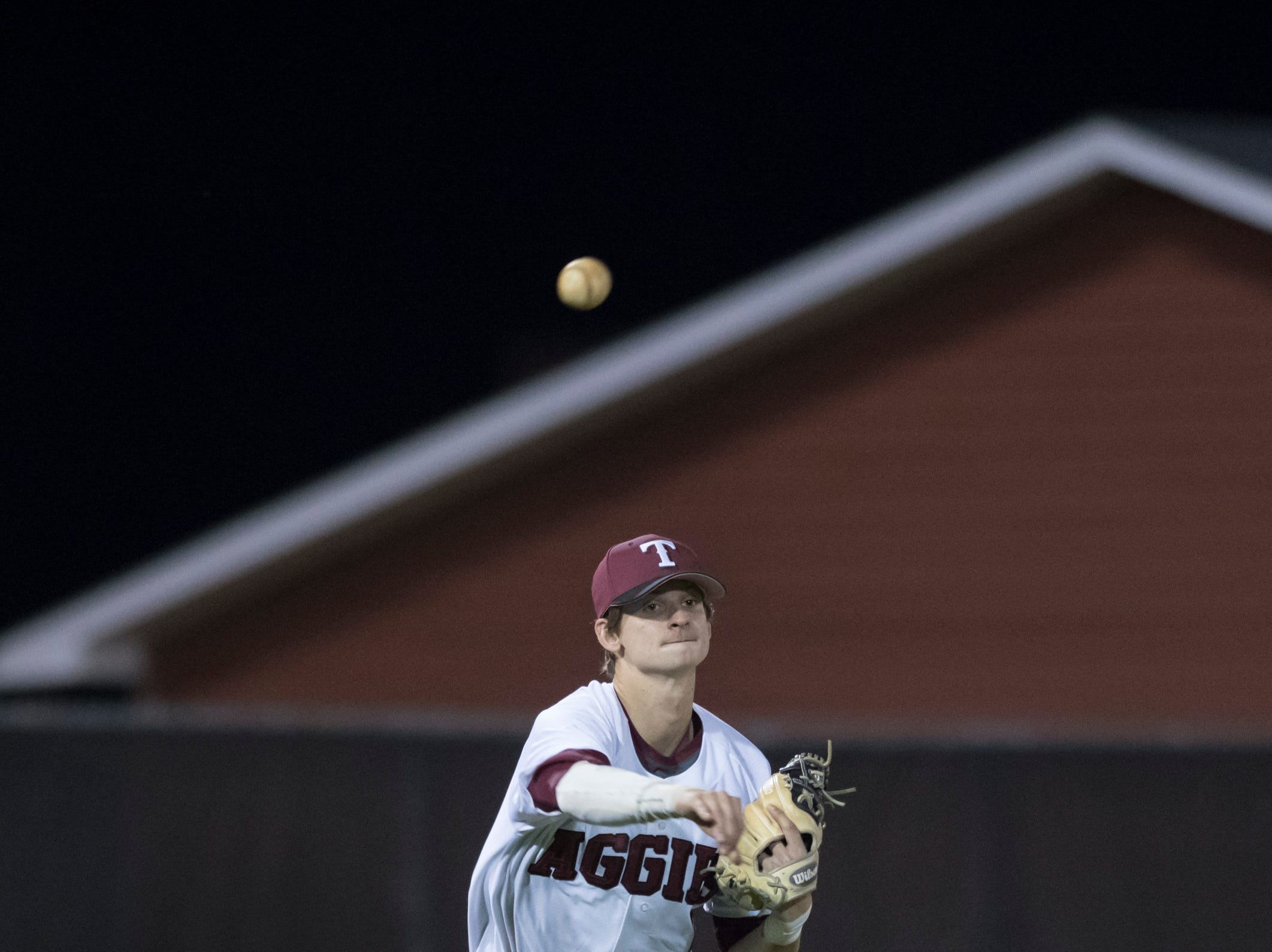 Third baseman Cole Fryman (2) throws to first for an out in the top of the 6th inning during the Pine Forest vs Tate baseball game at Tate High School on Thursday, March 7, 2019.  The Aggies won 4-3.