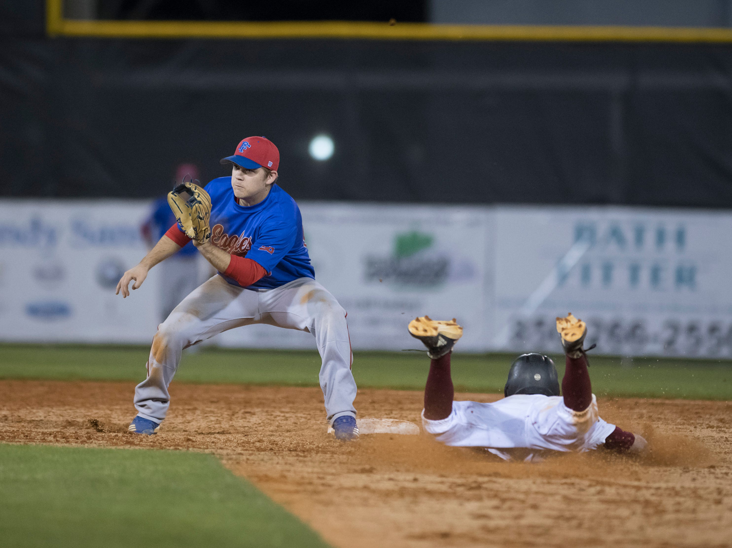 Aaron Noack (12) safely takes 2nd base ahead of the throw to Timmy Williams (20) during the Pine Forest vs Tate baseball game at Tate High School on Thursday, March 7, 2019.  The Aggies won 4-3.