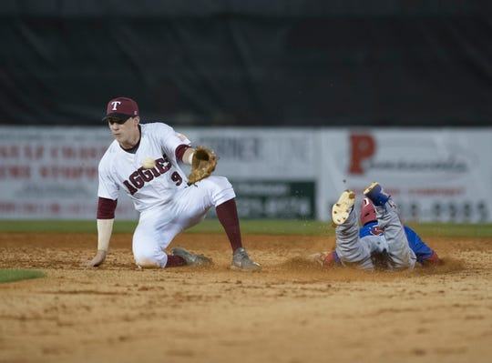 Jared Riddell (3) safely slides into second as the ball gets past Mason Land (9) during the Pine Forest vs Tate baseball game at Tate High School on Thursday, March 7, 2019.  However, (3) had to go back to first because the home umpire interfered with the catcher during the throw.  The Aggies won 4-3.