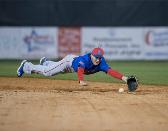 Second baseman John Pinette (2) dives for the ball as Kaden King (23) singles during the Pine Forest vs Tate baseball game at Tate High School on Thursday, March 7, 2019.  The Aggies won 4-3.
