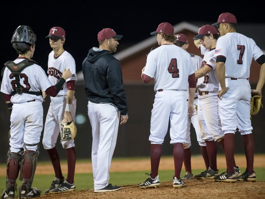The Aggies have a conference on the mound during the Pine Forest vs Tate baseball game at Tate High School on Thursday, March 7, 2019.