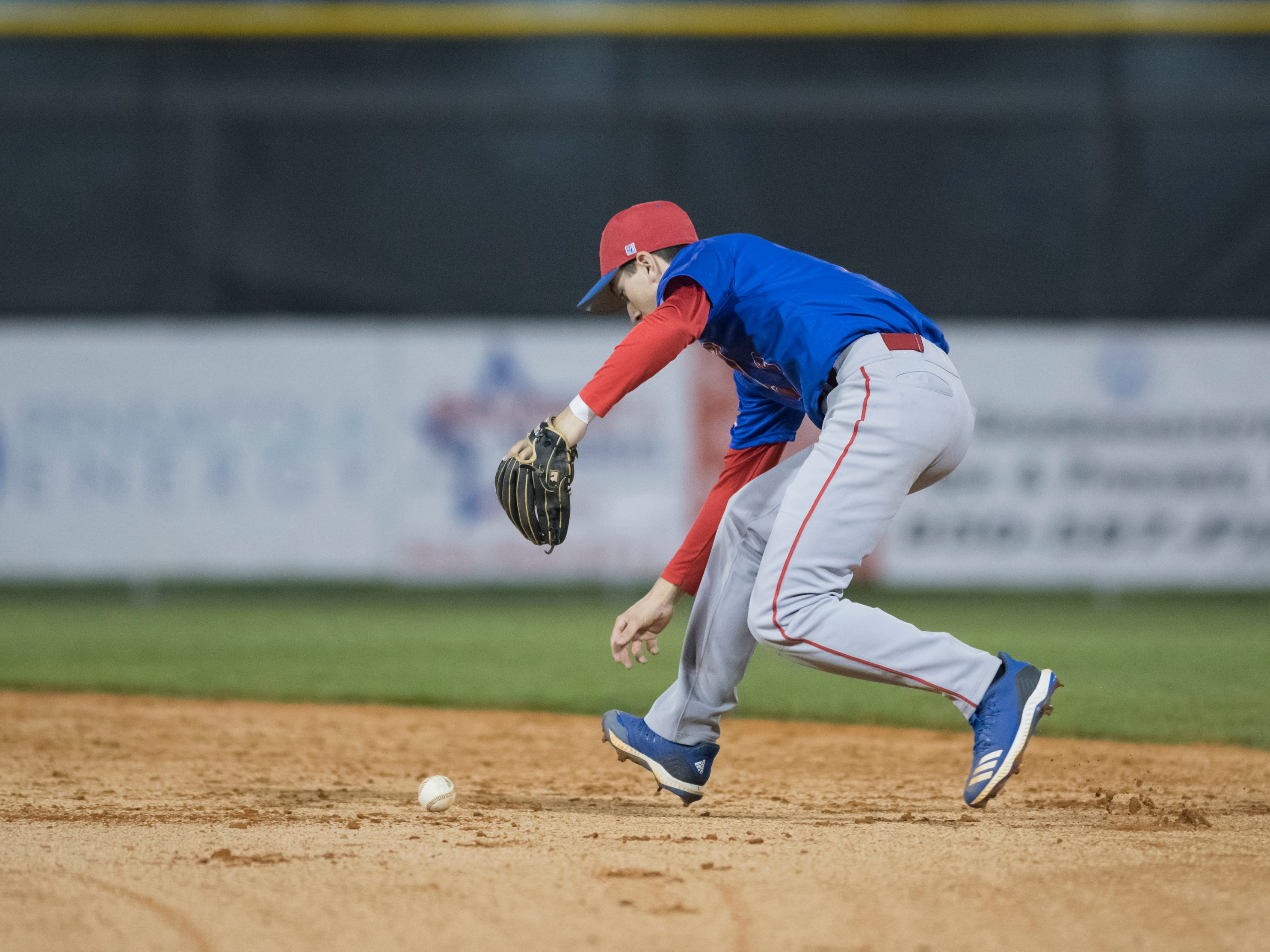 Second baseman John Pinette (2) plays a grounder to make the 2nd out in the bottom of the 1st inning during the Pine Forest vs Tate baseball game at Tate High School on Thursday, March 7, 2019.  The Aggies won 4-3.