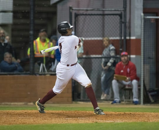 Darrien McDowell (3) bats during the Pine Forest vs Tate baseball game at Tate High School on Thursday, March 7, 2019.