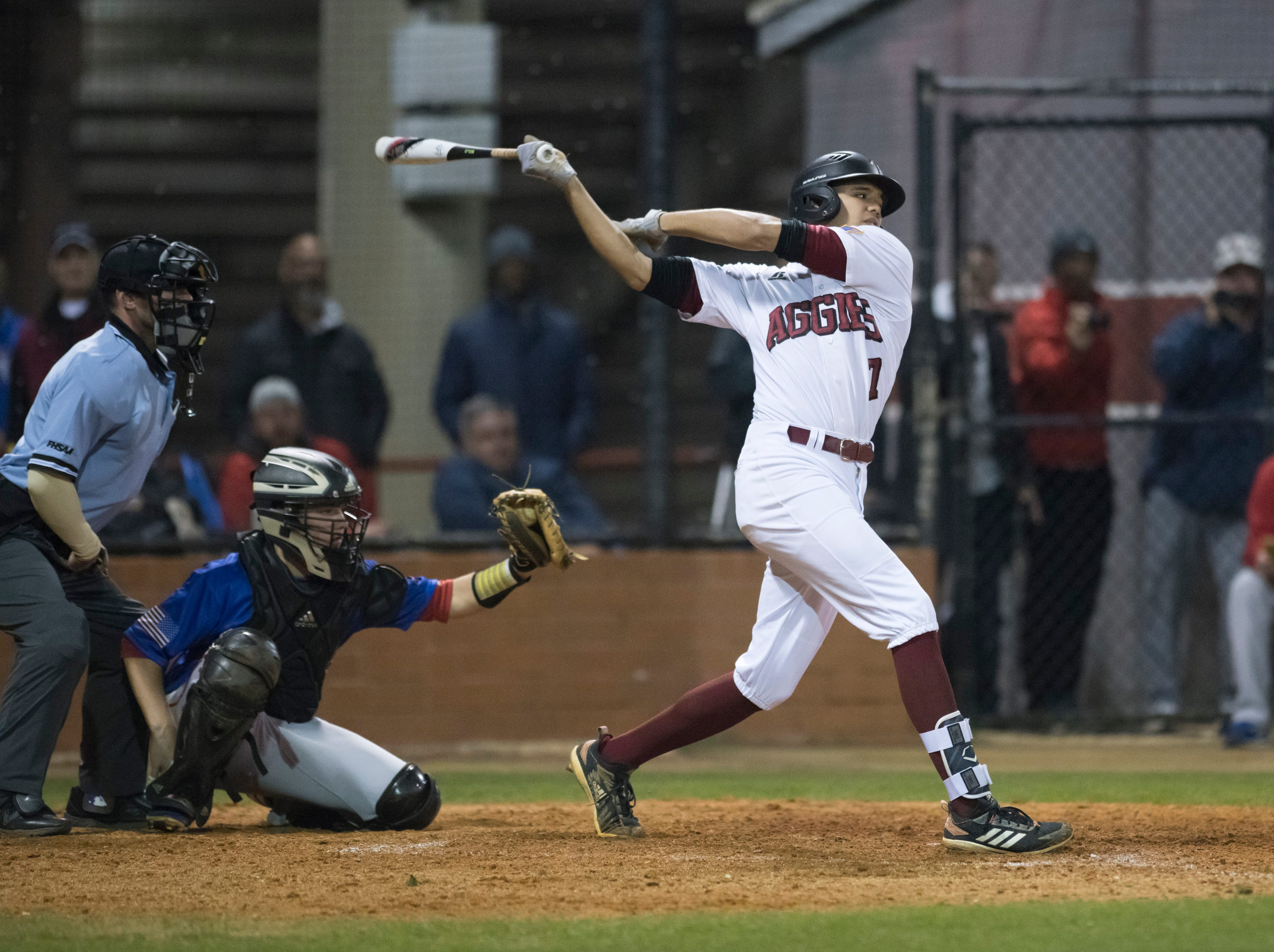 Raymond LaFleur (7) bats during the Pine Forest vs Tate baseball game at Tate High School on Thursday, March 7, 2019.  The Aggies won 4-3.