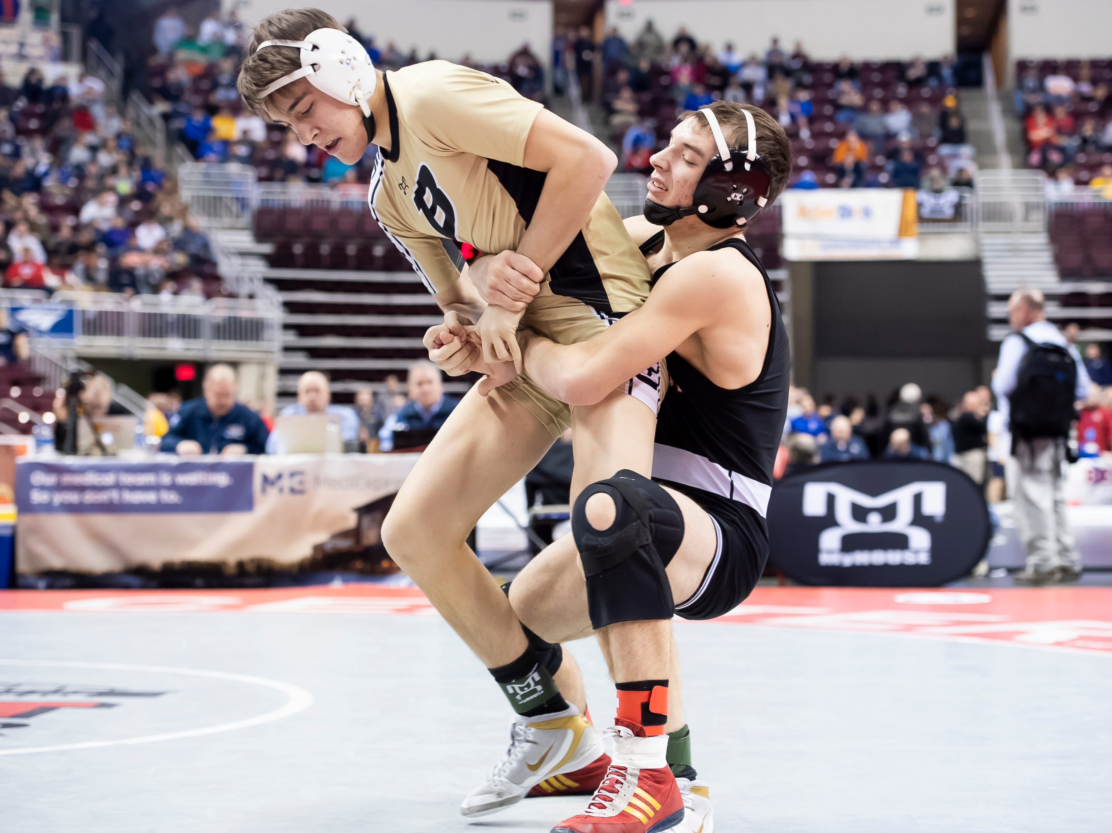 Biglerville's Josh Tuckey, left, tries to get away from Brockway's Anthony Glasl during a 126-pound second round consolation bout at the Giant Center in Hershey Friday, March 8, 2019. Glasl won by a 3-1 decision.