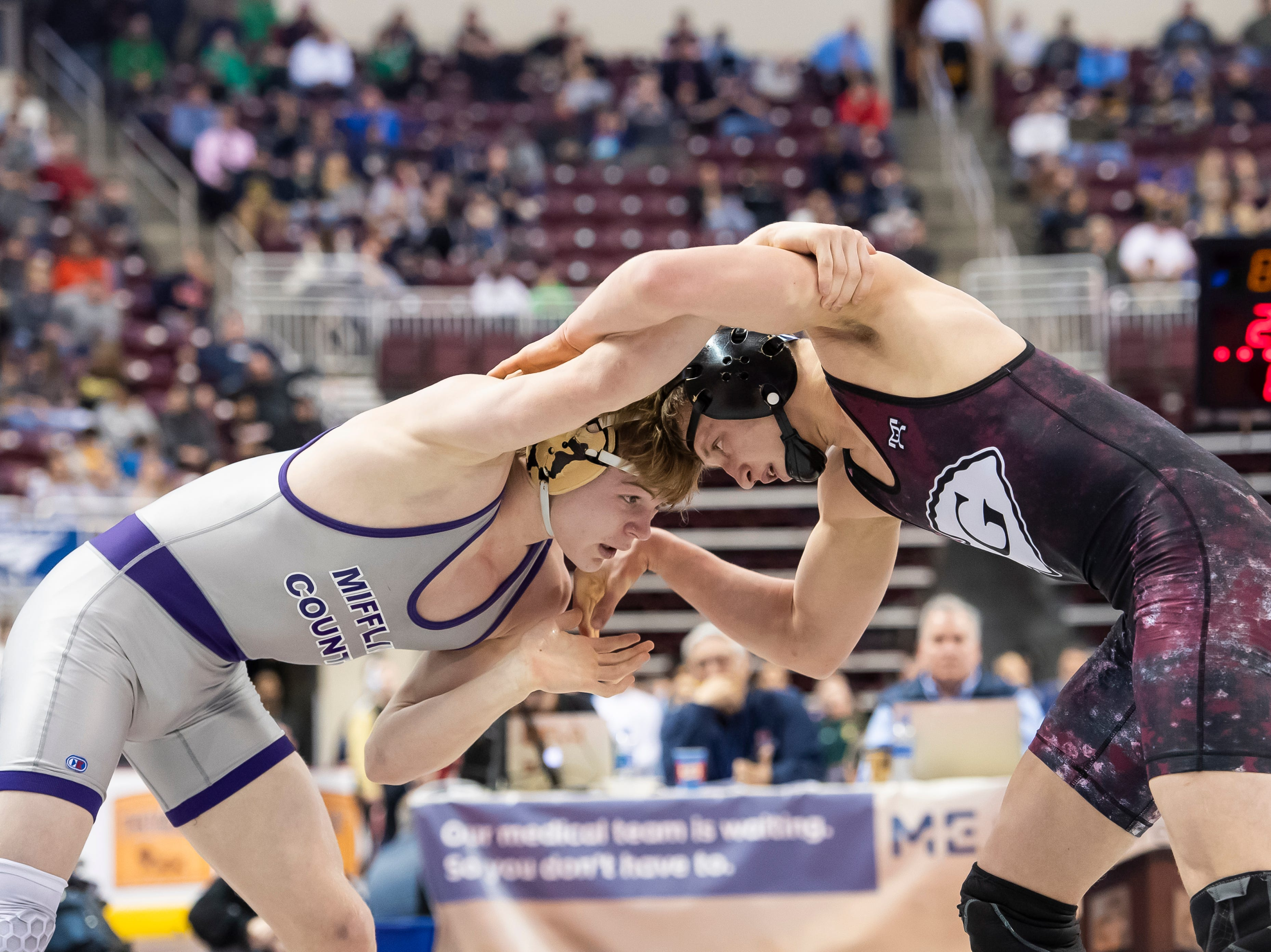 Gettysburg's Dylan Reinert, right, wrestles Mifflin County's Trey Kibe during the 3A 160-pound quarterfinal bout at the Giant Center in Hershey Friday, March 8, 2019. Kibe won 4-2 in sudden victory.