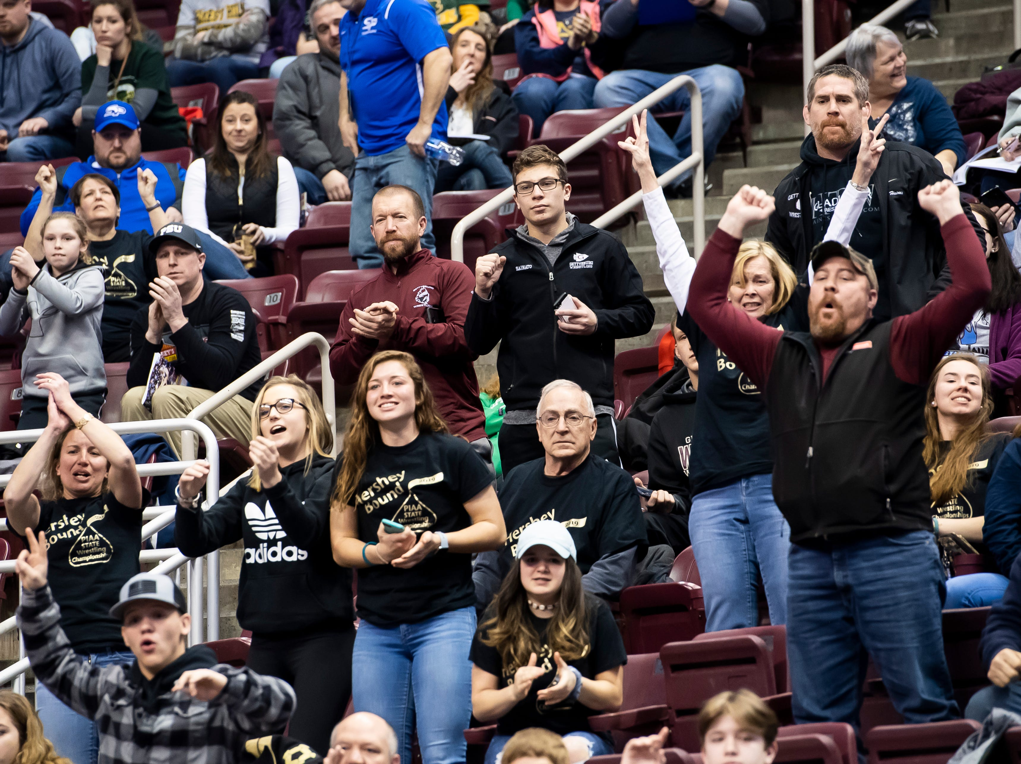Biglerville fans cheer as Eli Tuckey comes from behind to defeat Newport's Dorian Gonzalez during a 132-pound second round consolation bout at the Giant Center in Hershey Friday, March 8, 2019. Tuckey won in sudden victory 9-7.