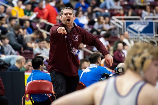 Gettysburg head coach Chris Haines motions as Dylan Reinert wrestles Mifflin County's Trey Kibe during the 3A 160-pound quarterfinal bout at the Giant Center in Hershey Friday, March 8, 2019. Kibe won 4-2 in sudden victory.