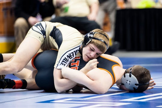 Biglerville's Blake Showers, top, wrestles Milton's Kyler Crawford during a 120-pound second round consolation bout at the Giant Center in Hershey Friday, March 8, 2019. Showers won by fall 4:02.