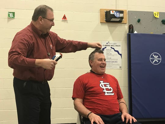 Clearview Elementary School principal Jay Czap gets his head shaved by Washington Elementary School principal Thomas Krout on March 8, 2019 as part of a school fundraiser.