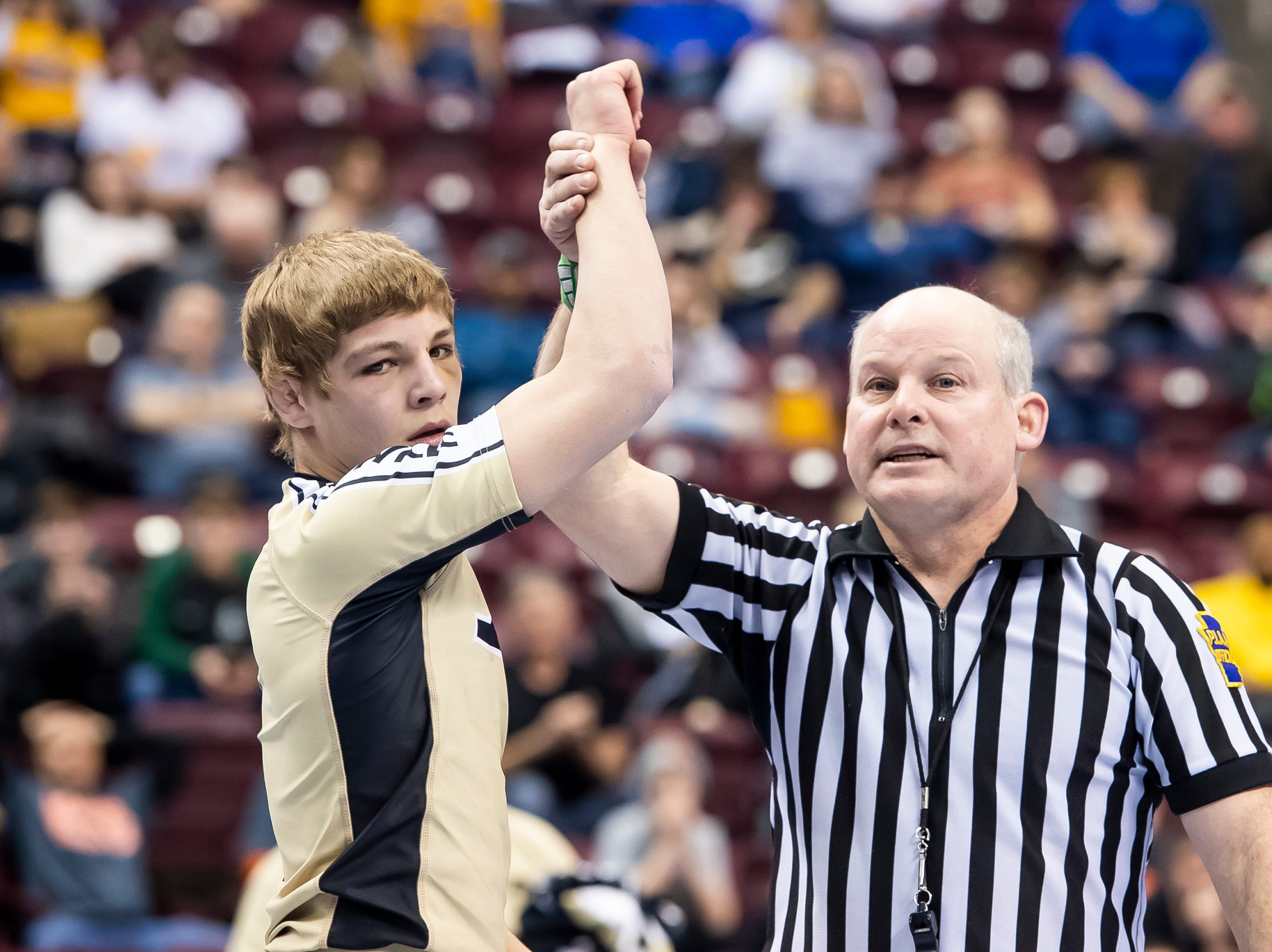 Biglerville's Blake Showers has his hand raised after defeating Milton's Kyler Crawford during a 120-pound second round consolation bout at the Giant Center in Hershey Friday, March 8, 2019. Showers won by fall 4:02.