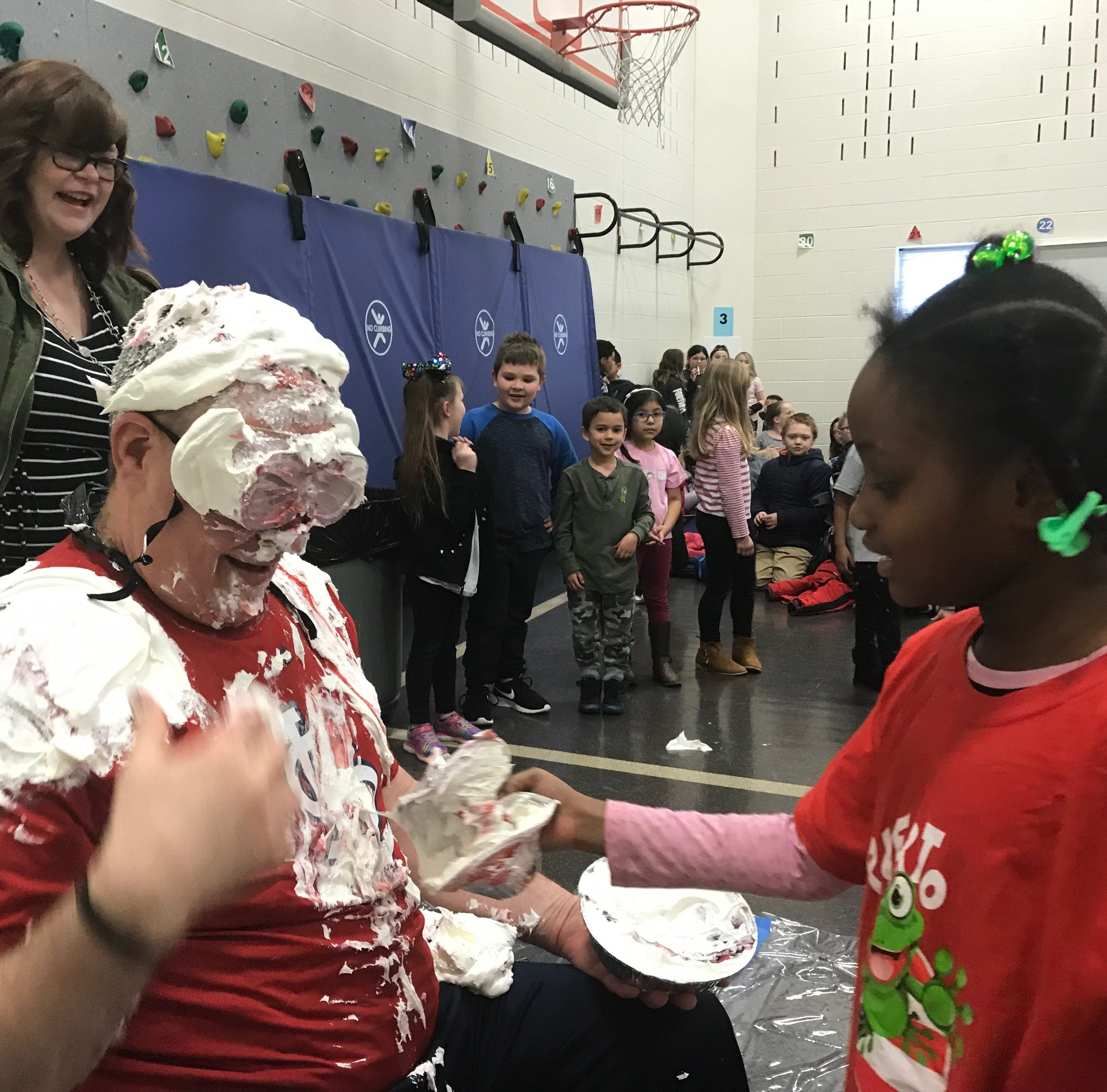 'My hair will grow back': Clearview principal shaves head, gets pied in face