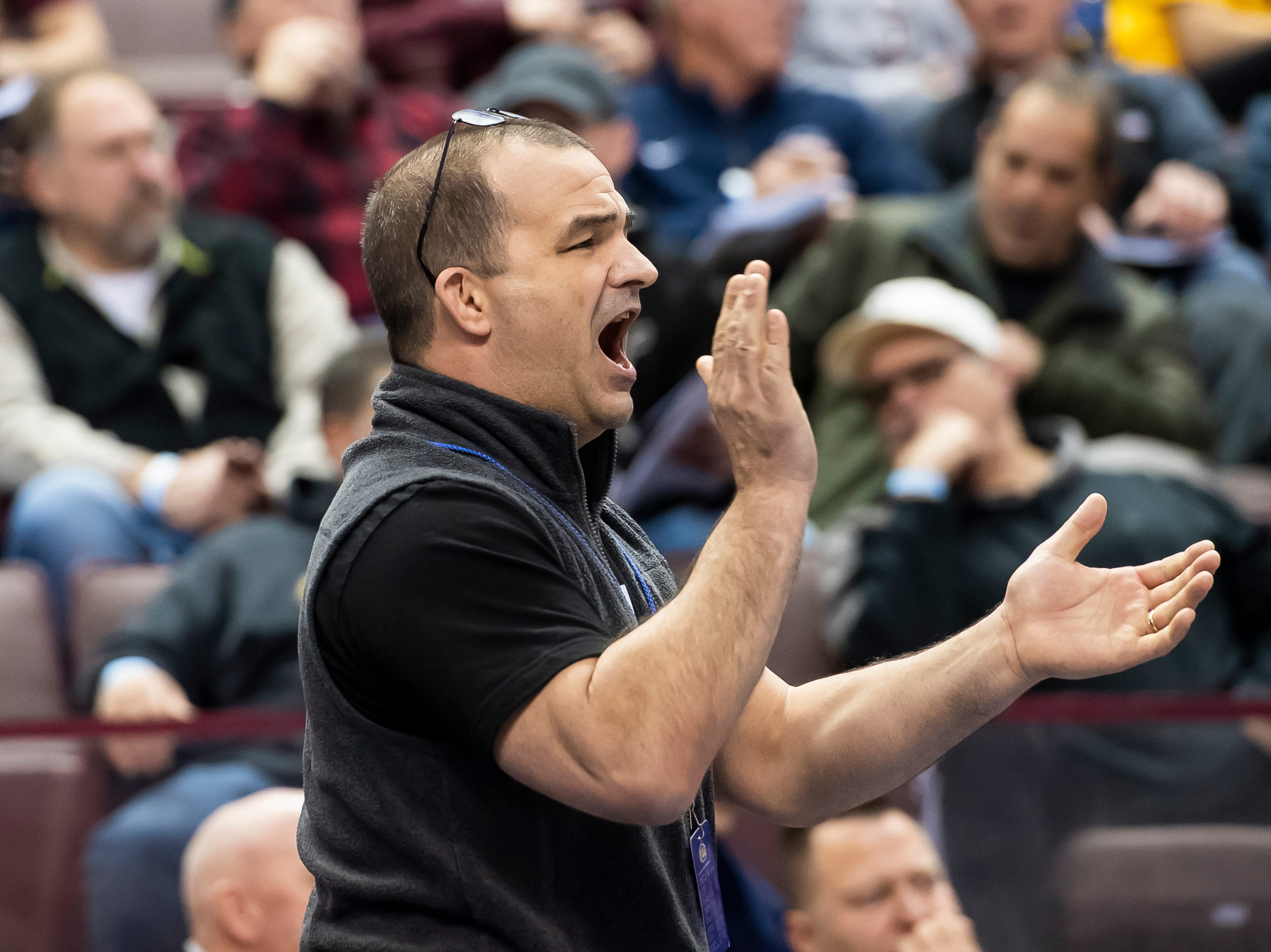 Chambersburg head coach Matt Mentzer claps as Karl Shindledecker defeats Becahi's Matt Mayer during the 3A 113-pound quarterfinal bout at the Giant Center in Hershey Friday, March 8, 2019. Shindledecker won a 3-2 decision.