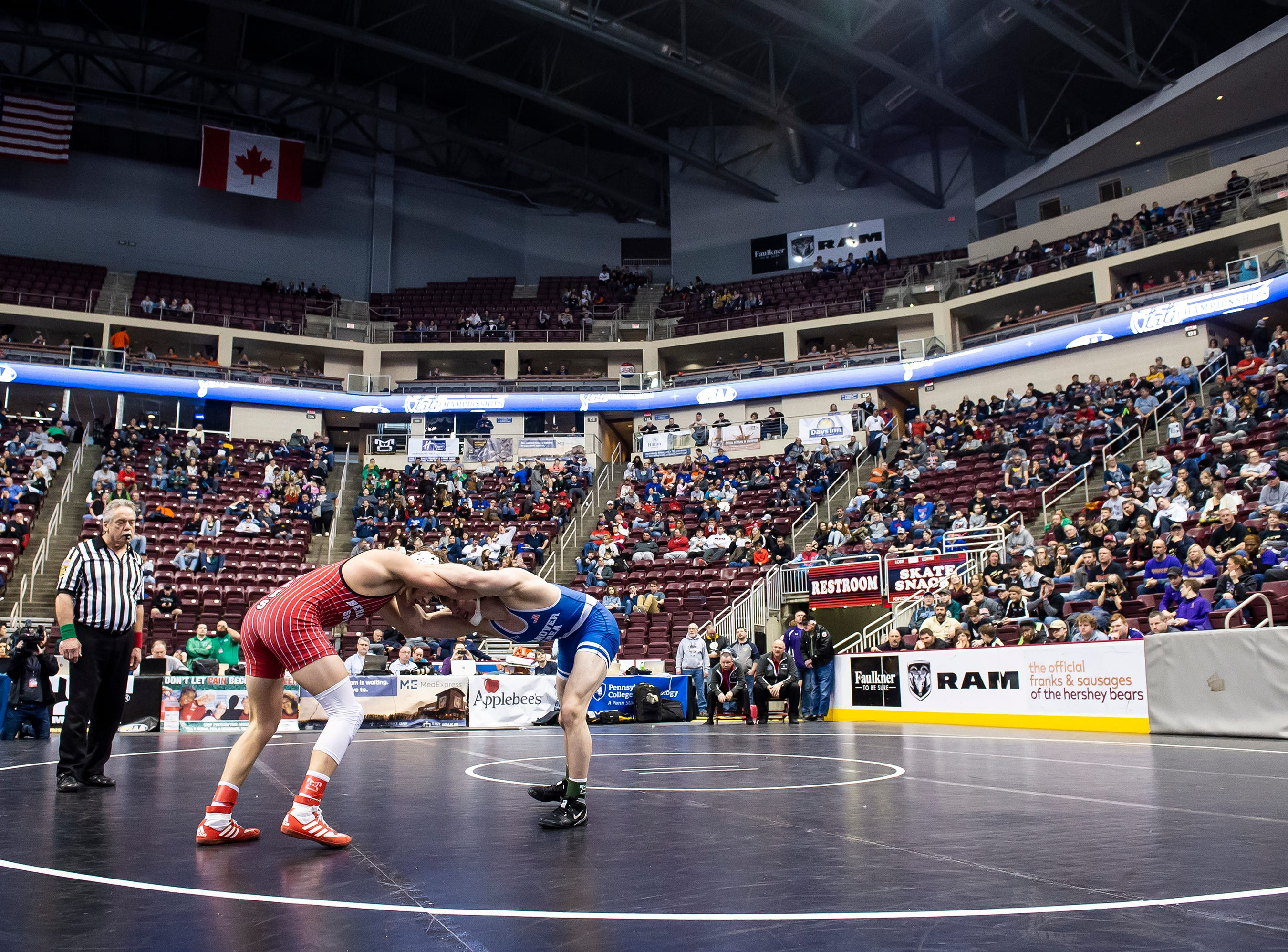 Bermudian Springs' Trenton Harder, left, wrestles Hanover Area's D.J. Erickson during the 2A 152-pound quarterfinal bout in the PIAA State Championships at the Giant Center in Hershey Friday, March 8, 2019. Harder won by a 3-2 decision.