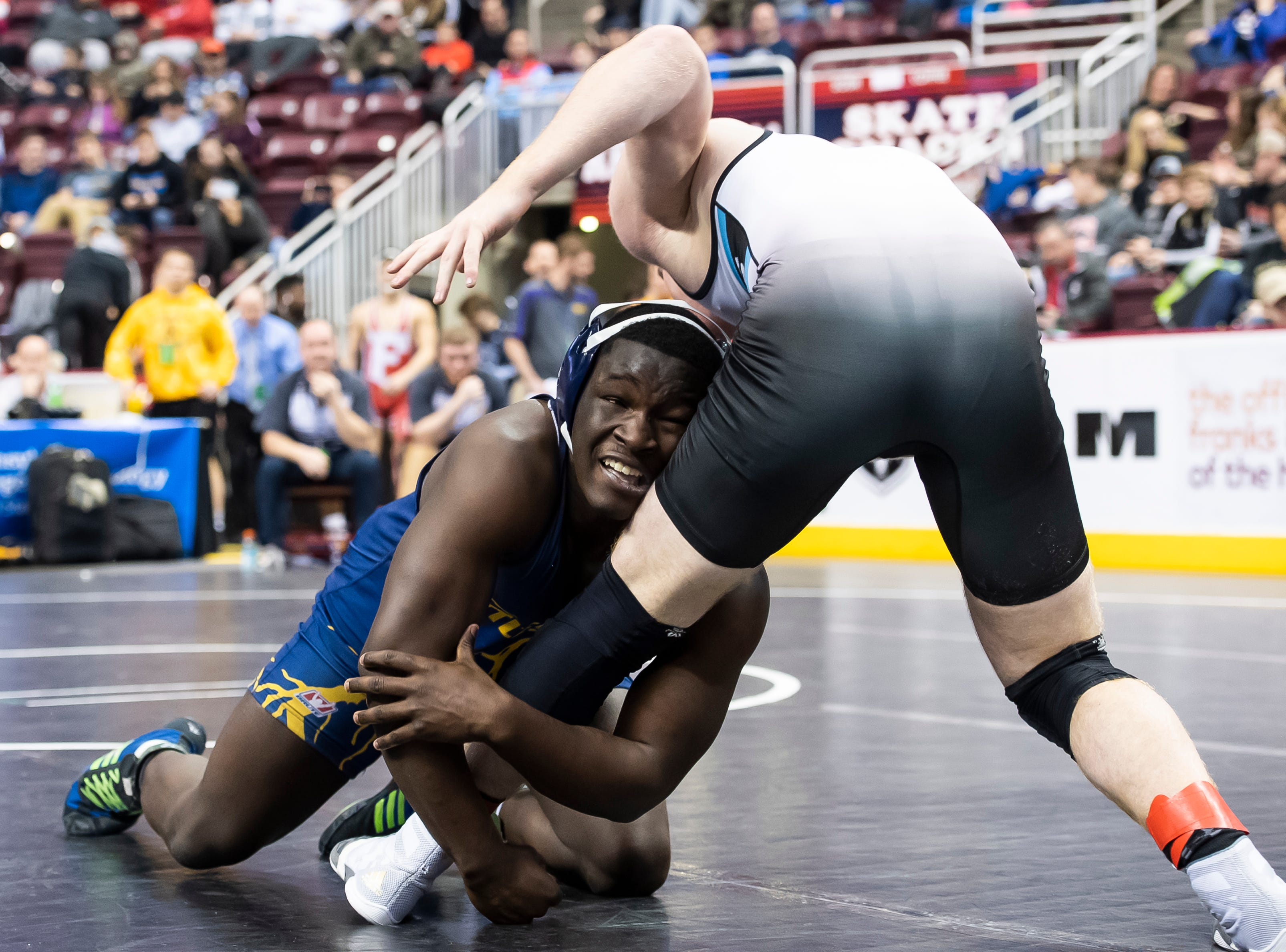Littlestown's Carl Harris, bottom, wrestles Penn Cambria's Derek Brown during a 2A 170-pound quarterfinal bout at the Giant Center in Hershey Friday, March 8, 2019. Brown won by a 10-3 decision.