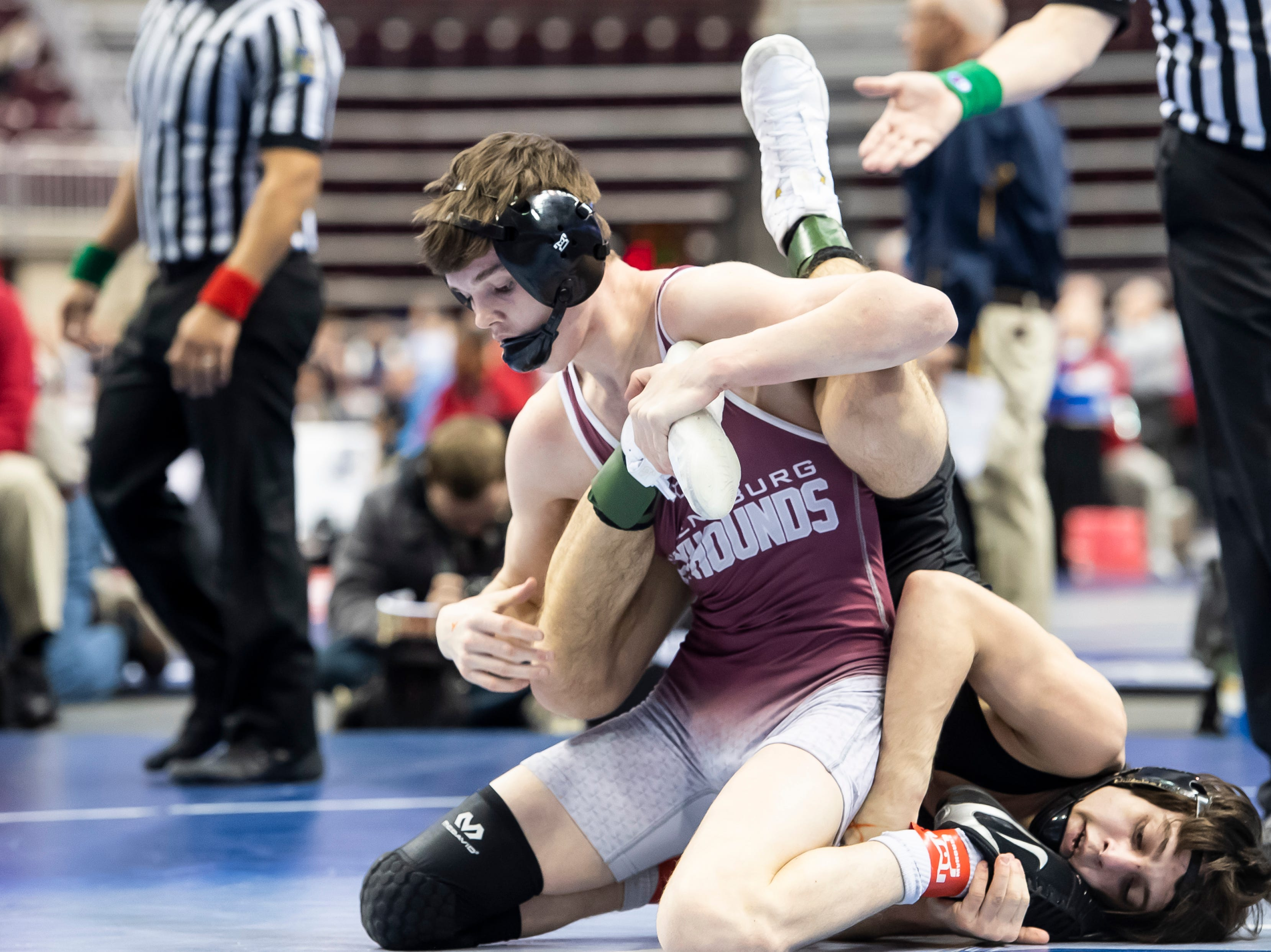 Shippensburg's Jeffrey Russell, front, wrestles William Tennet's T.J. England during a 3A 120-pound second round consolation bout at the Giant Center in Hershey Friday, March 8, 2019. Haines won by a 4-2 decision.