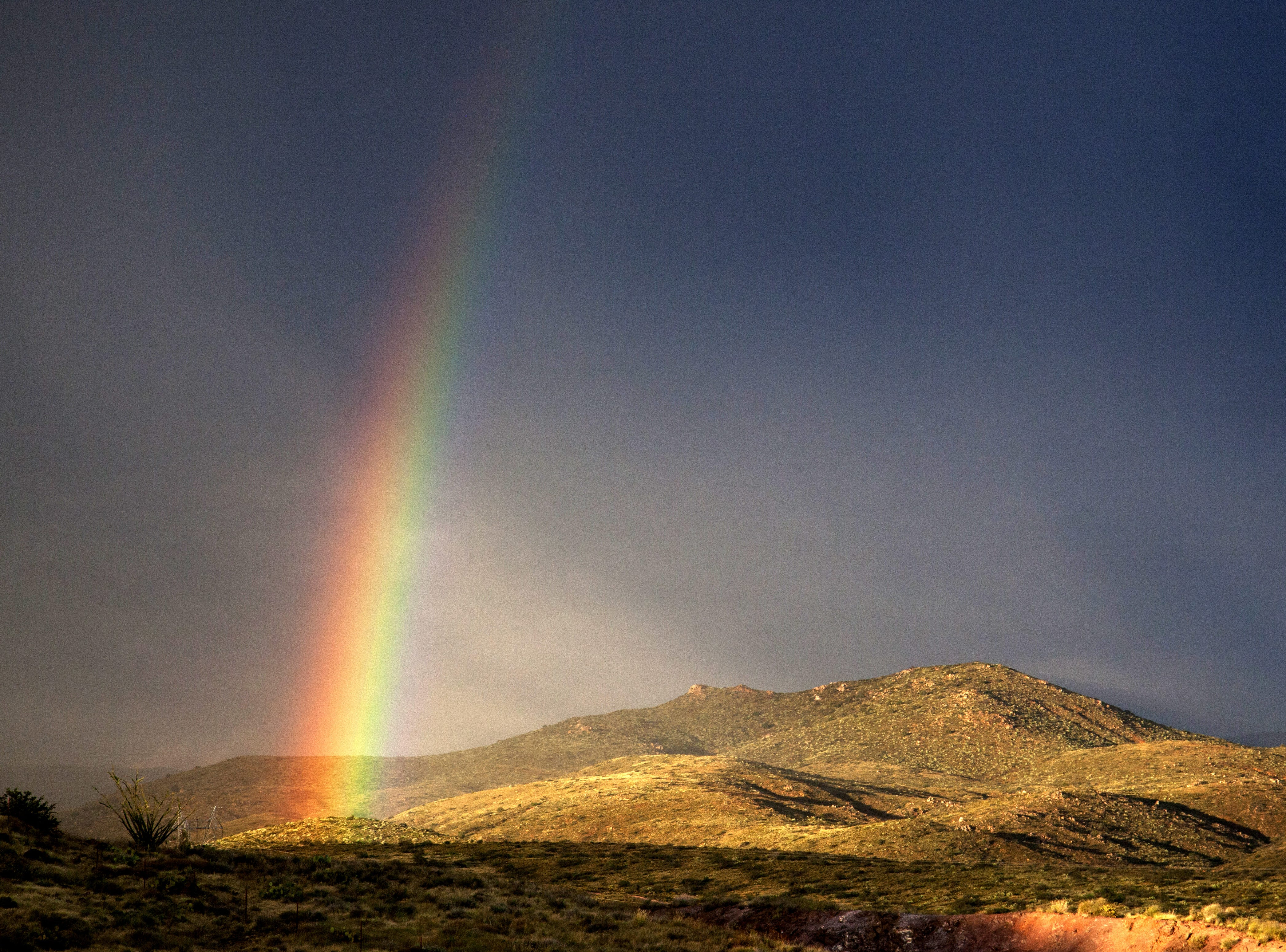 A rainbow shines over I-17 after an afternoon rainstorm near Sunset Point.