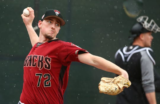 Taylor Clarke pitches during a spring training workout at Salt River Fields.