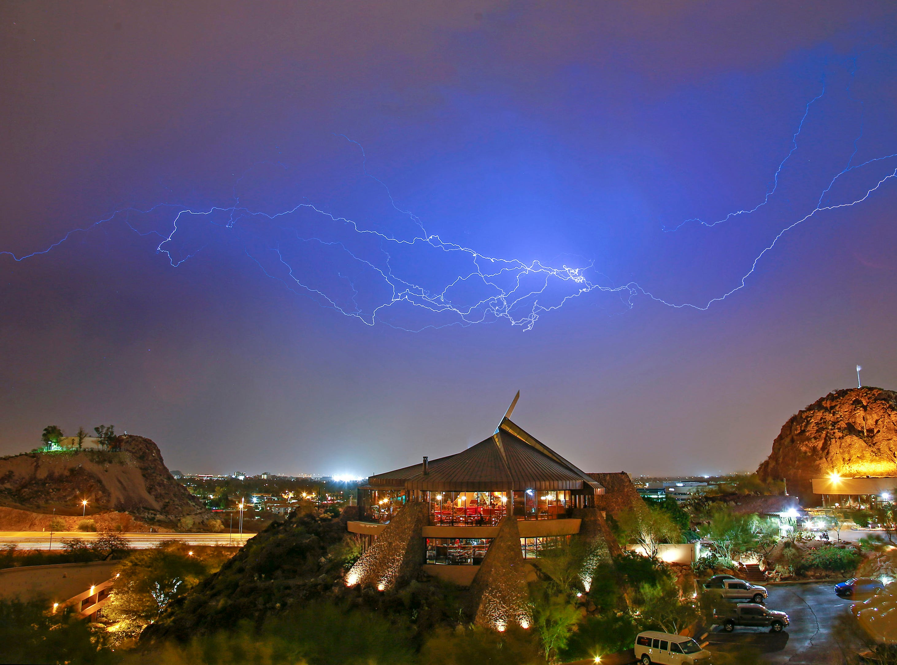 Lightning flashes in the sky above the Phoenix Marriott Tempe at The Buttes in Tempe, Ariz.
