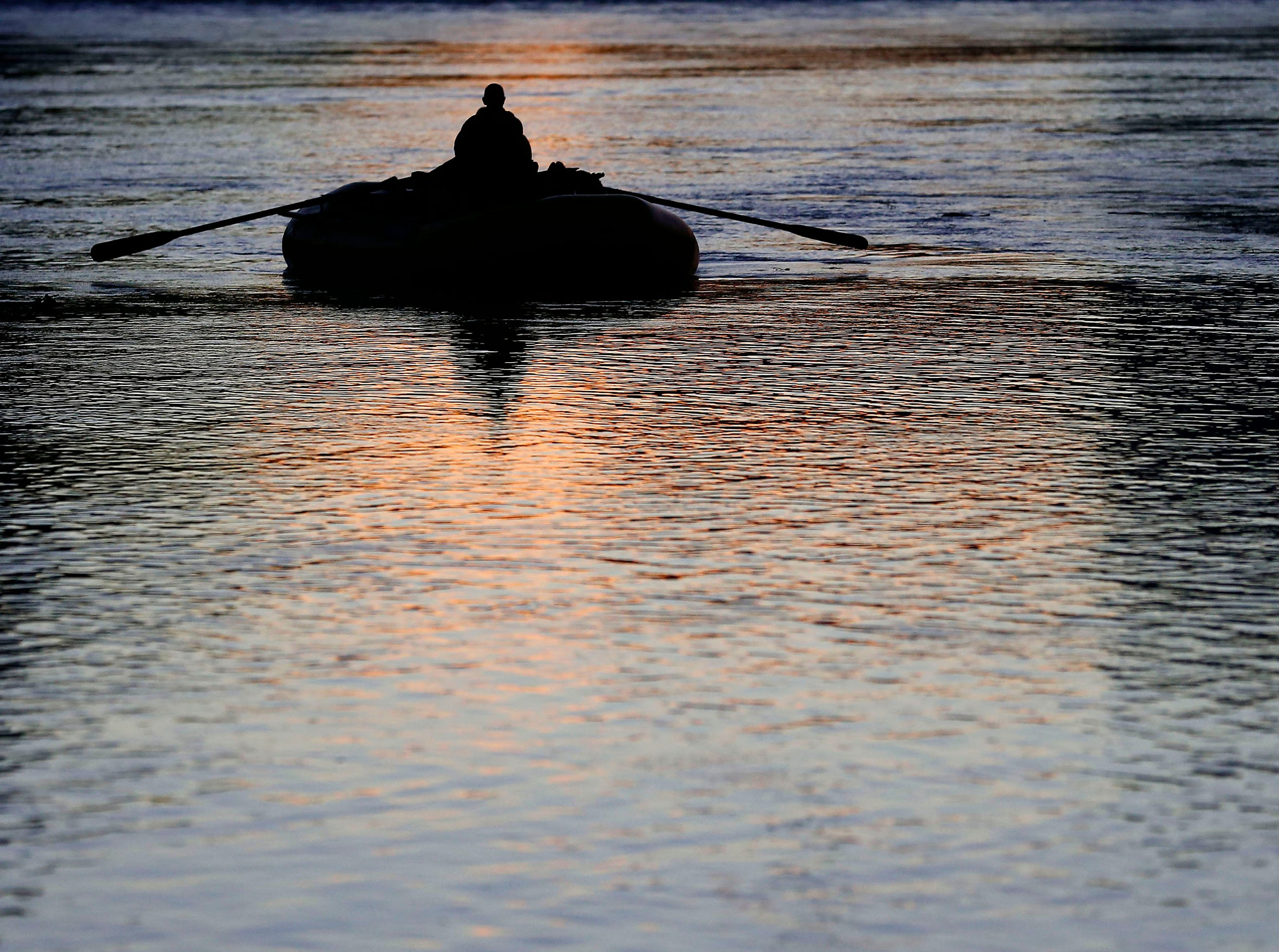 A rafter floats down the Colorado River at Lee's Ferry in north Arizona.