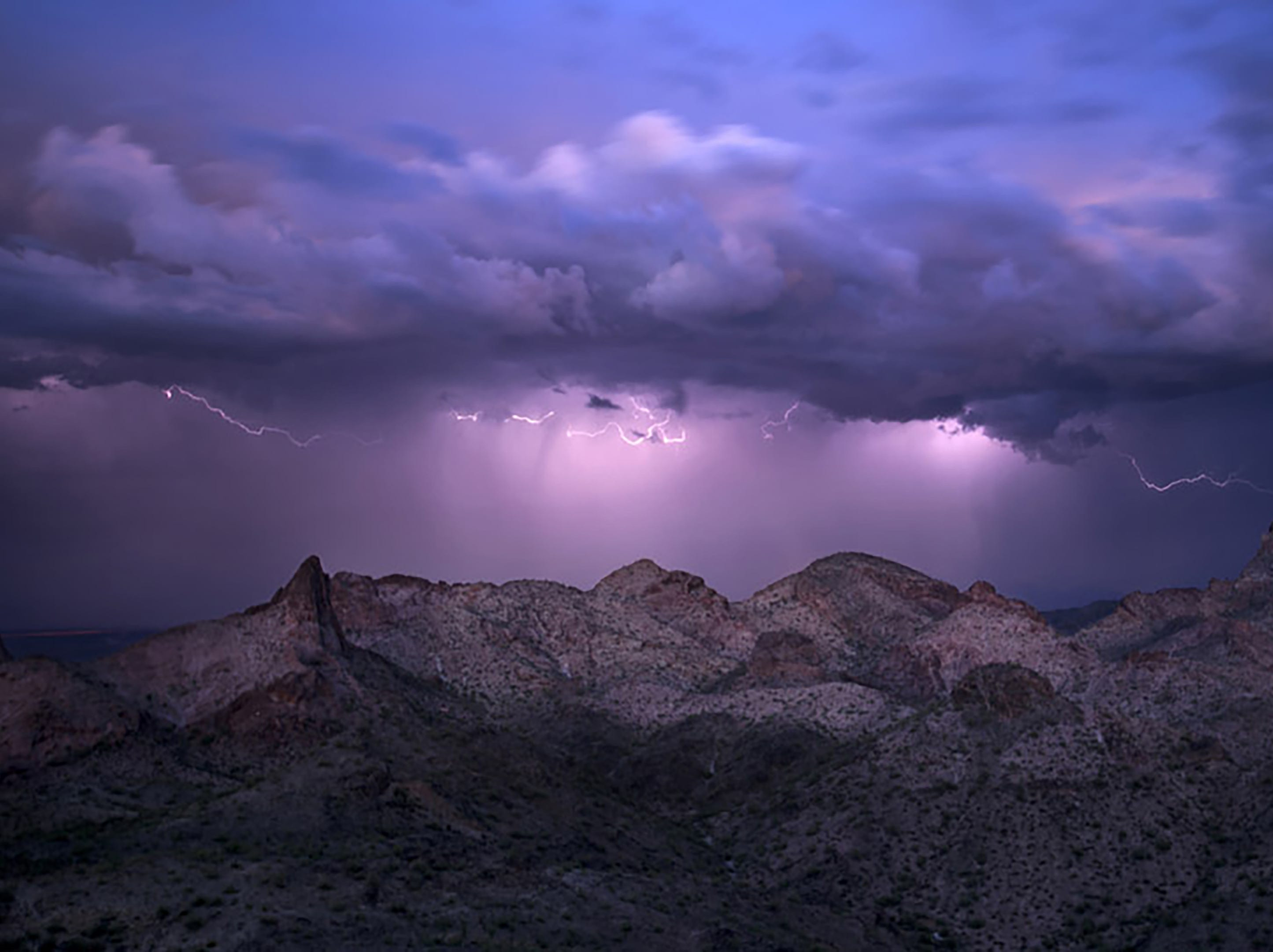 Lightning is seen over the Eagletail Mountains outside of Tonopah.