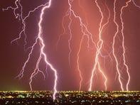 Lightning bolts strike the Phoenix skyline during a summer monsoon storm.
