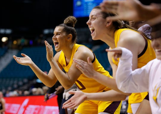 Arizona State's Taya Hanson, left, cheers with teammates during the second half of an NCAA college basketball game against Colorado at the Pac-12 women's tournament Thursday, March 7, 2019, in Las Vegas. (AP Photo/John Locher)