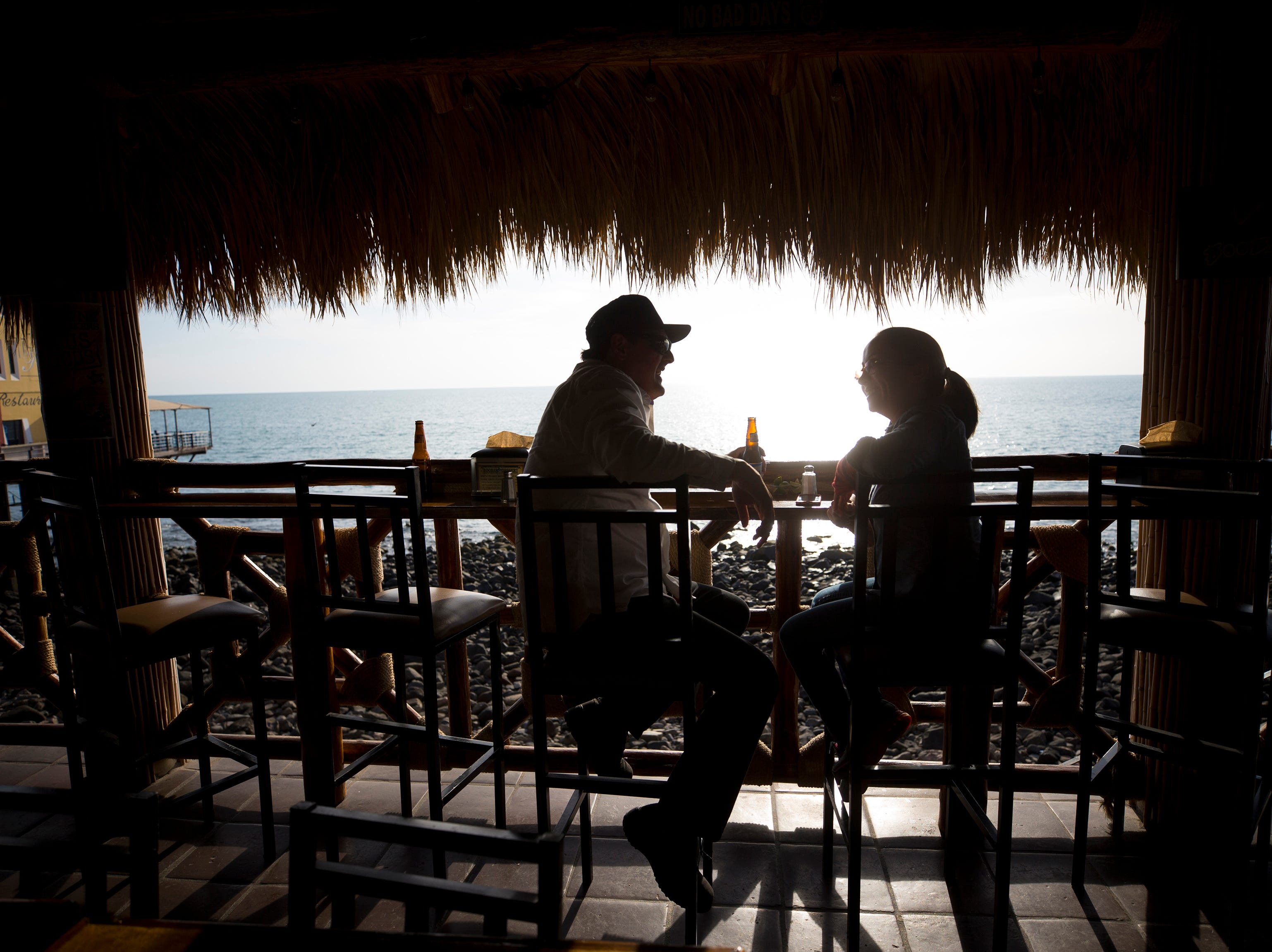 Orlando Cruz and Daniela Celaya of Tucson, enjoy a drink late afternoon at BooBar Cantina at the Malecon in Puerto Penasco, Mexico.