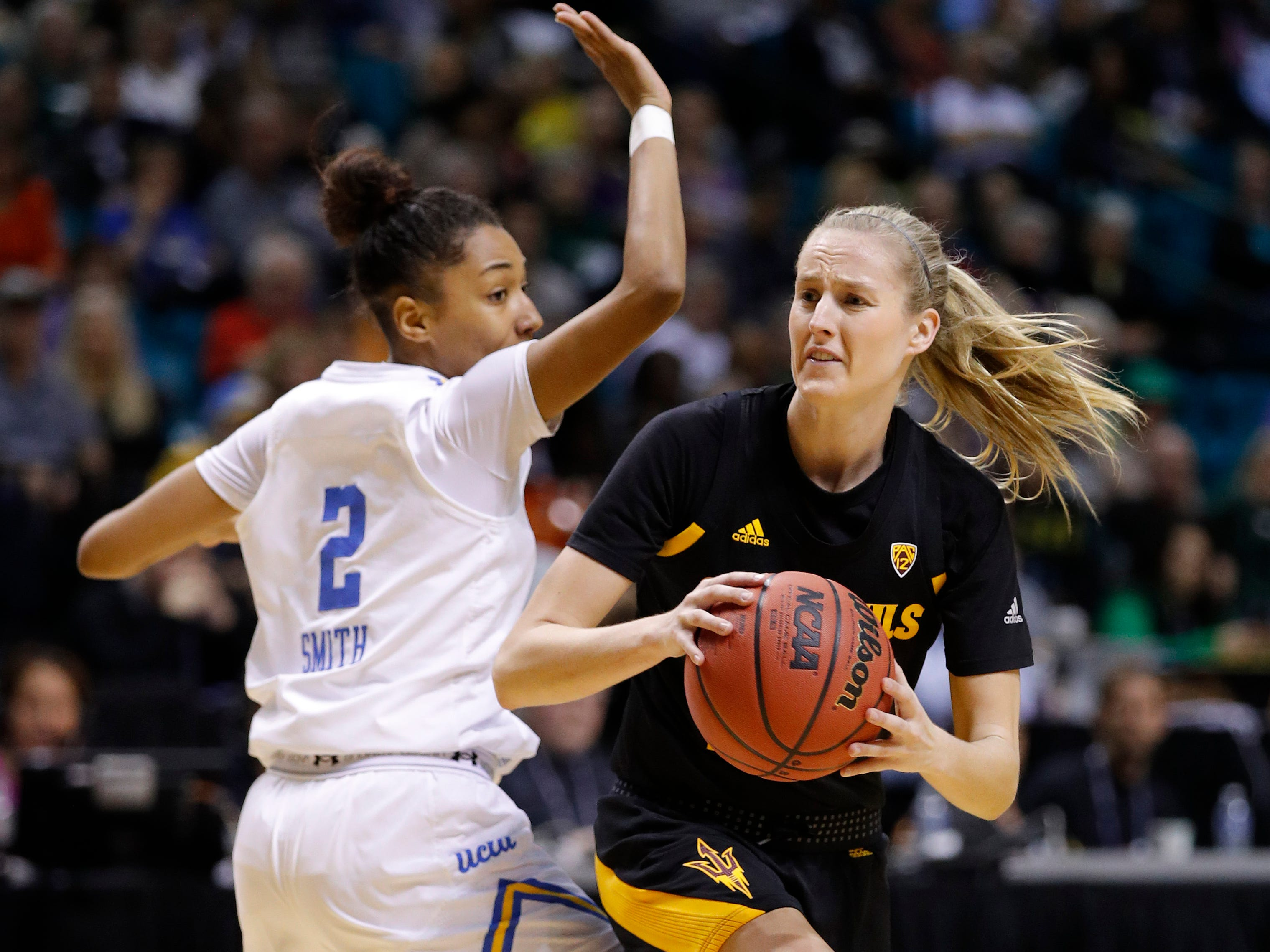 Arizona State's Courtney Ekmark passes around UCLA's Ahlana Smith during the first half of an NCAA college basketball game at the Pac-12 women's tournament Friday, March 8, 2019, in Las Vegas.