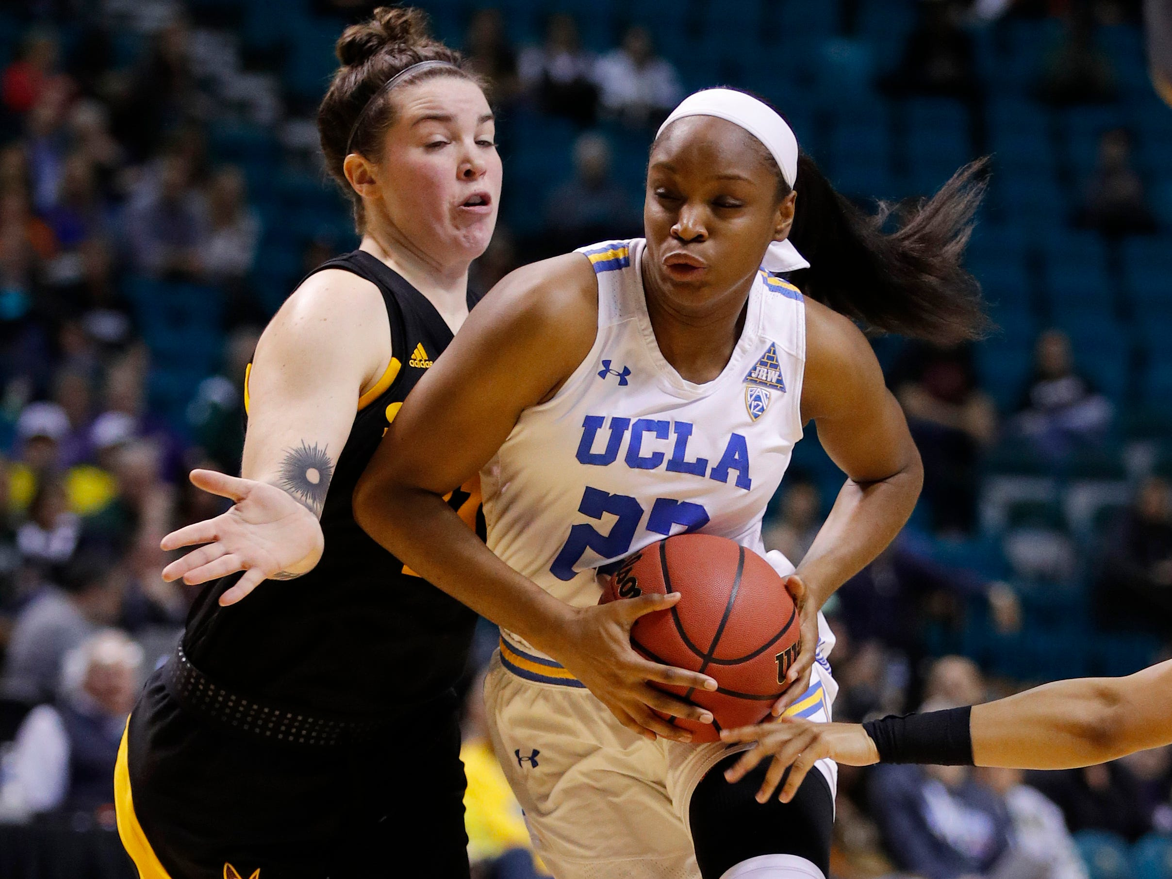 UCLA's Kennedy Burke drives around Arizona State's Robbi Ryan during the second half of an NCAA college basketball game at the Pac-12 women's tournament Friday, March 8, 2019, in Las Vegas.